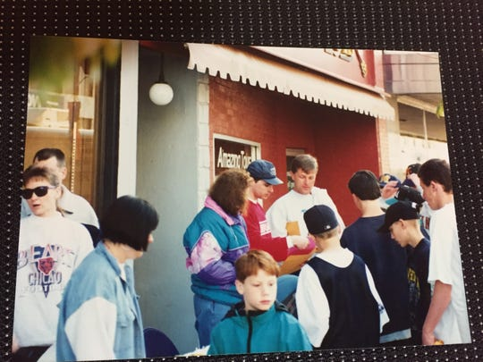 Standing behind the registration table in 1995 were, from left, Rita Kuka, Dirk Gibson and Mark Tronson.