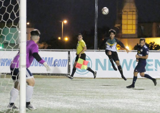 Jordan Rosario takes a shot on goal for the UOG Tritons against FC Beercelona Friday in the Guam Football Association's Challenge Cup by the Bank of Guam at the GFA National Training Center.