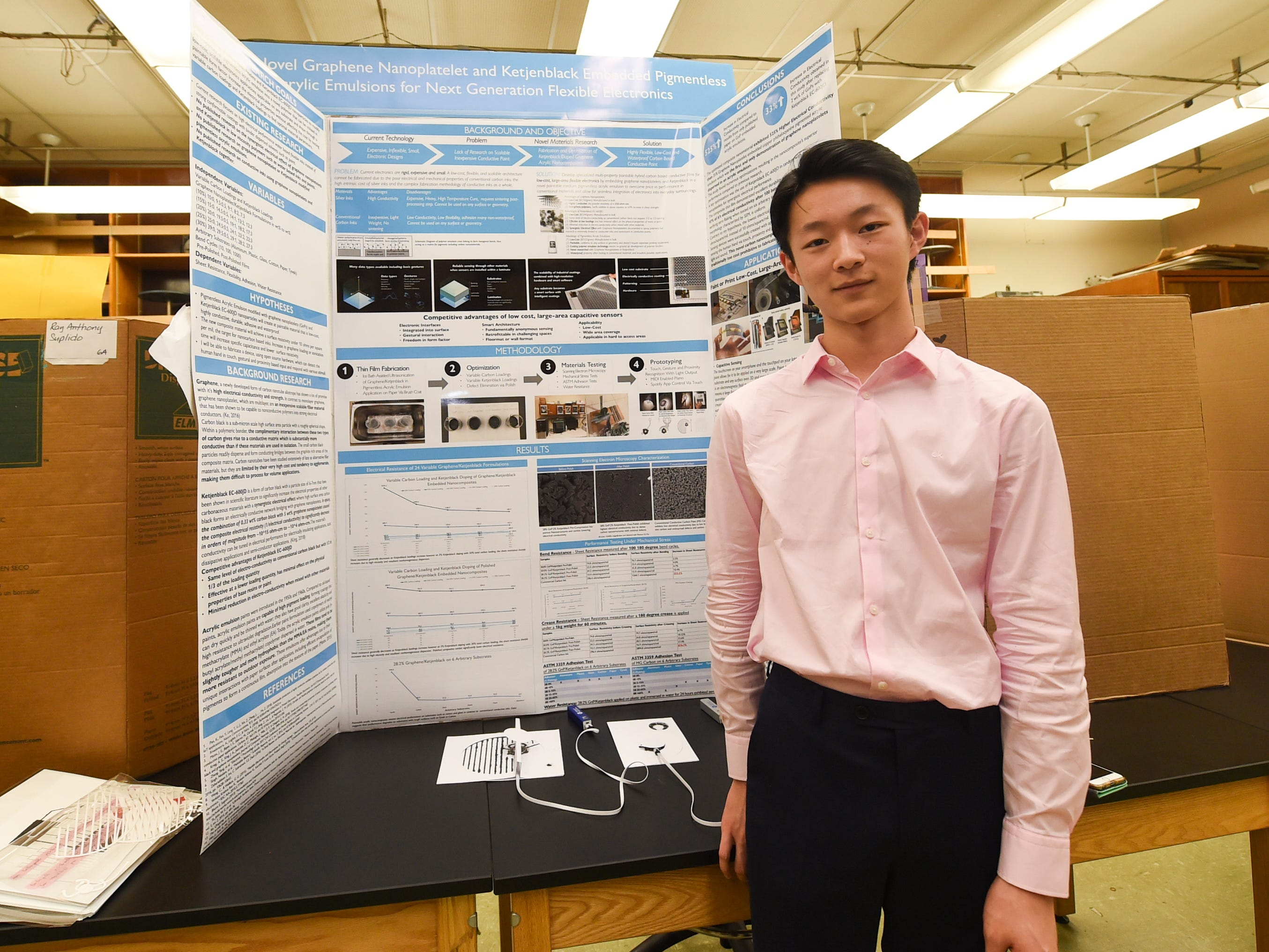 John F. Kennedy High School junior Daniel Kang, 17, created electrically conductive paint displayed here for the 41st Annual Islandwide Science Fair at the University of Guam in Mangilao, May 11, 2019.