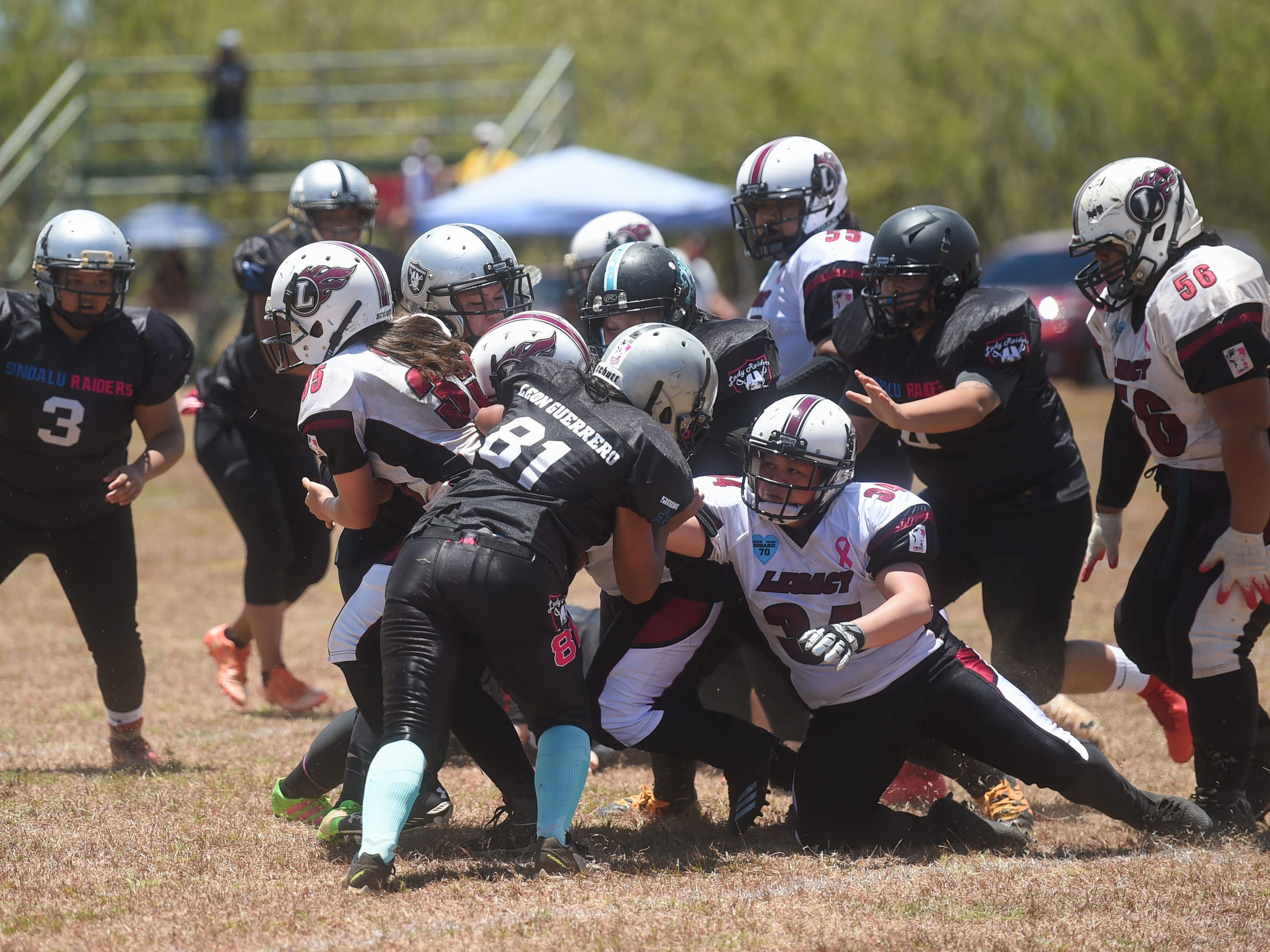 A Legacy run is stopped by the Sindalu/Raiders' defense during their 2019 Bud Light GWTFL game at the University of Guam Field in Mangilao, May 11, 2019. Legacy came away with a 20-0 victory for their second game of the season.
