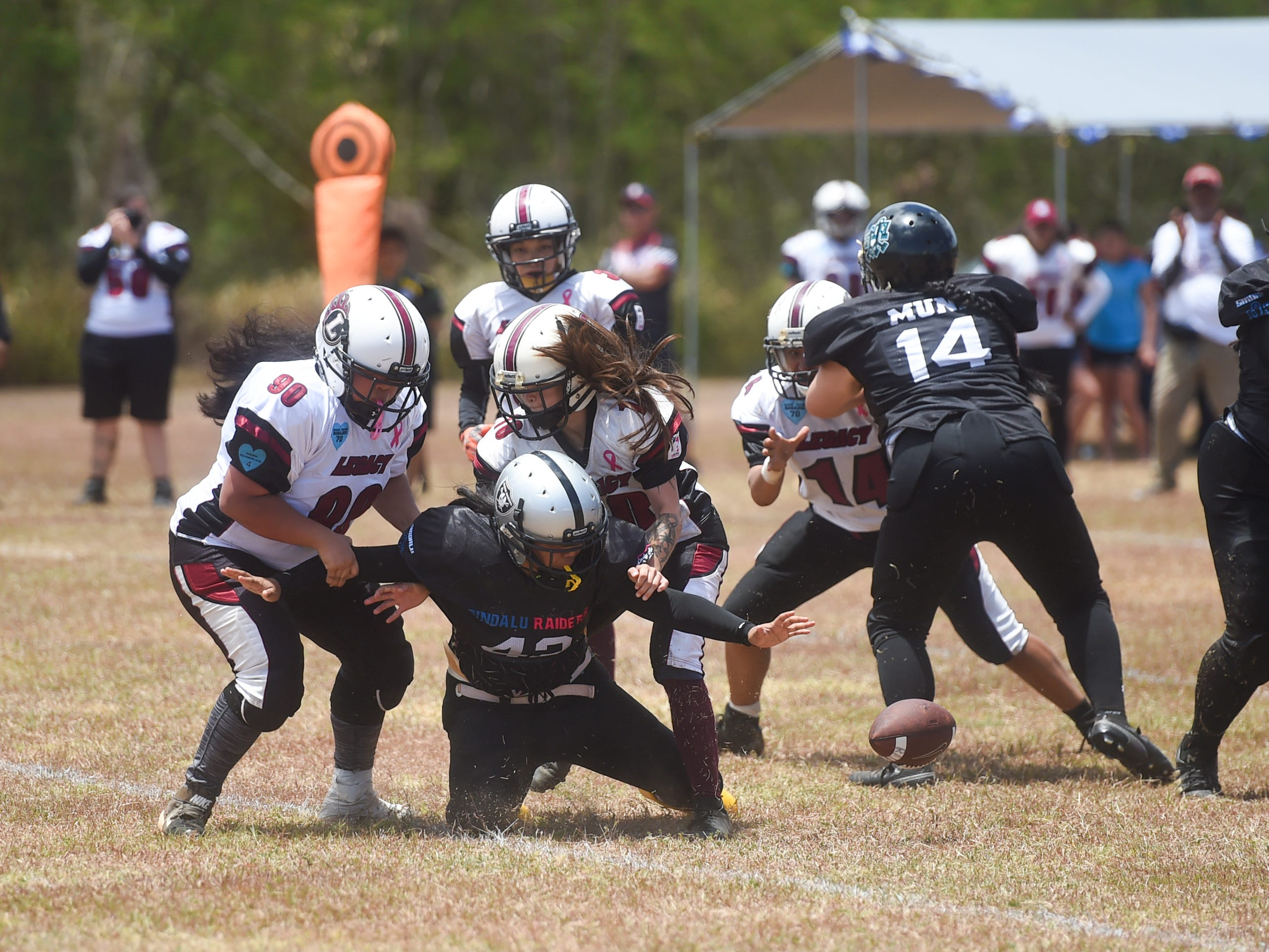 Legacy players force a fumble against the Sindalu/Raiders during their 2019 Bud Light GWTFL game at the University of Guam Field in Mangilao, May 11, 2019. Legacy came away with a 20-0 victory for their second game of the season.