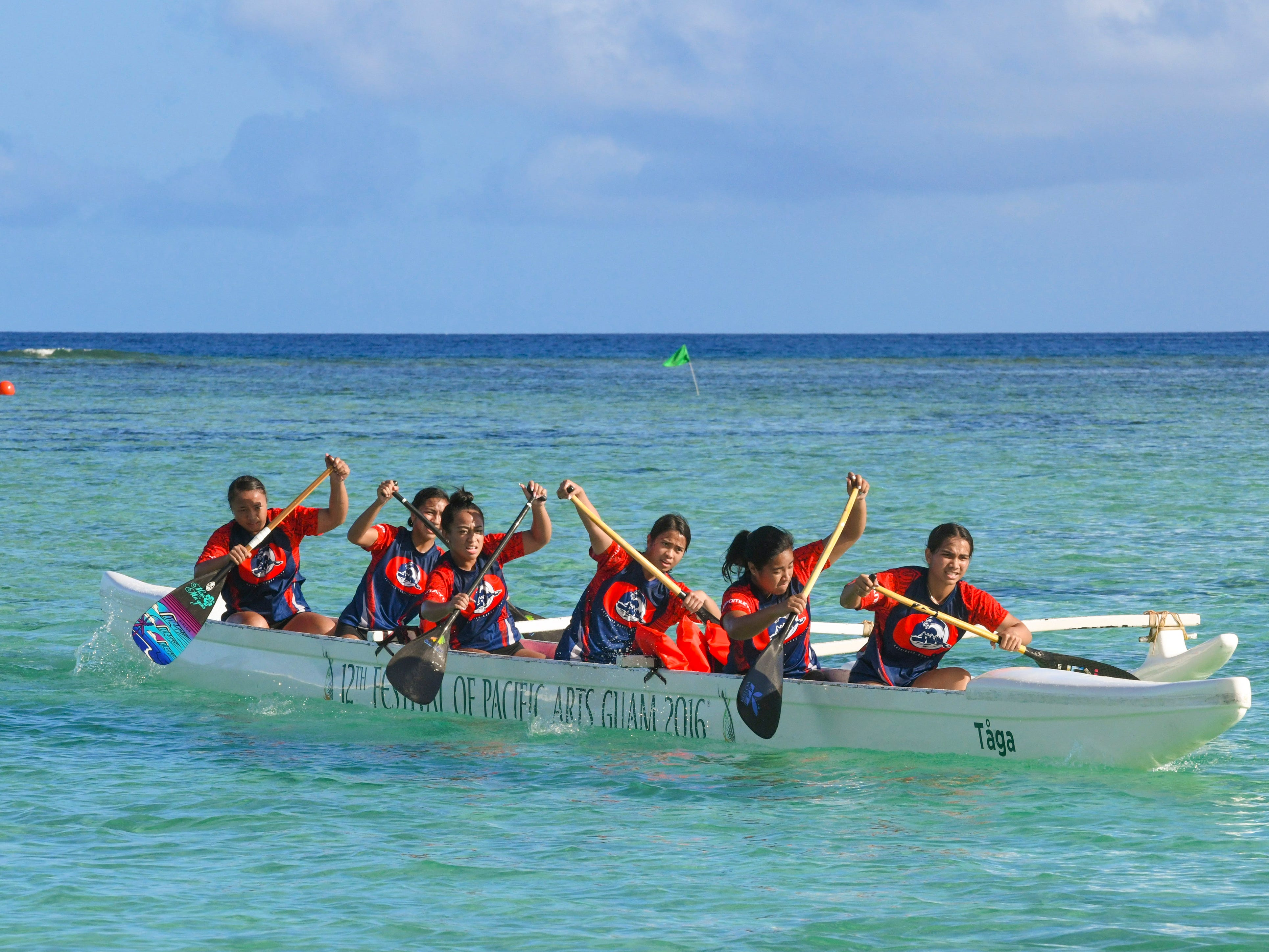 Bulldog paddlers from Okkodo High School prepare to dig into the waters off Matapang Beach as they compete in an IIAAG Paddling competition preliminary race against other teams in Tumon on Saturday, May 11, 2019.