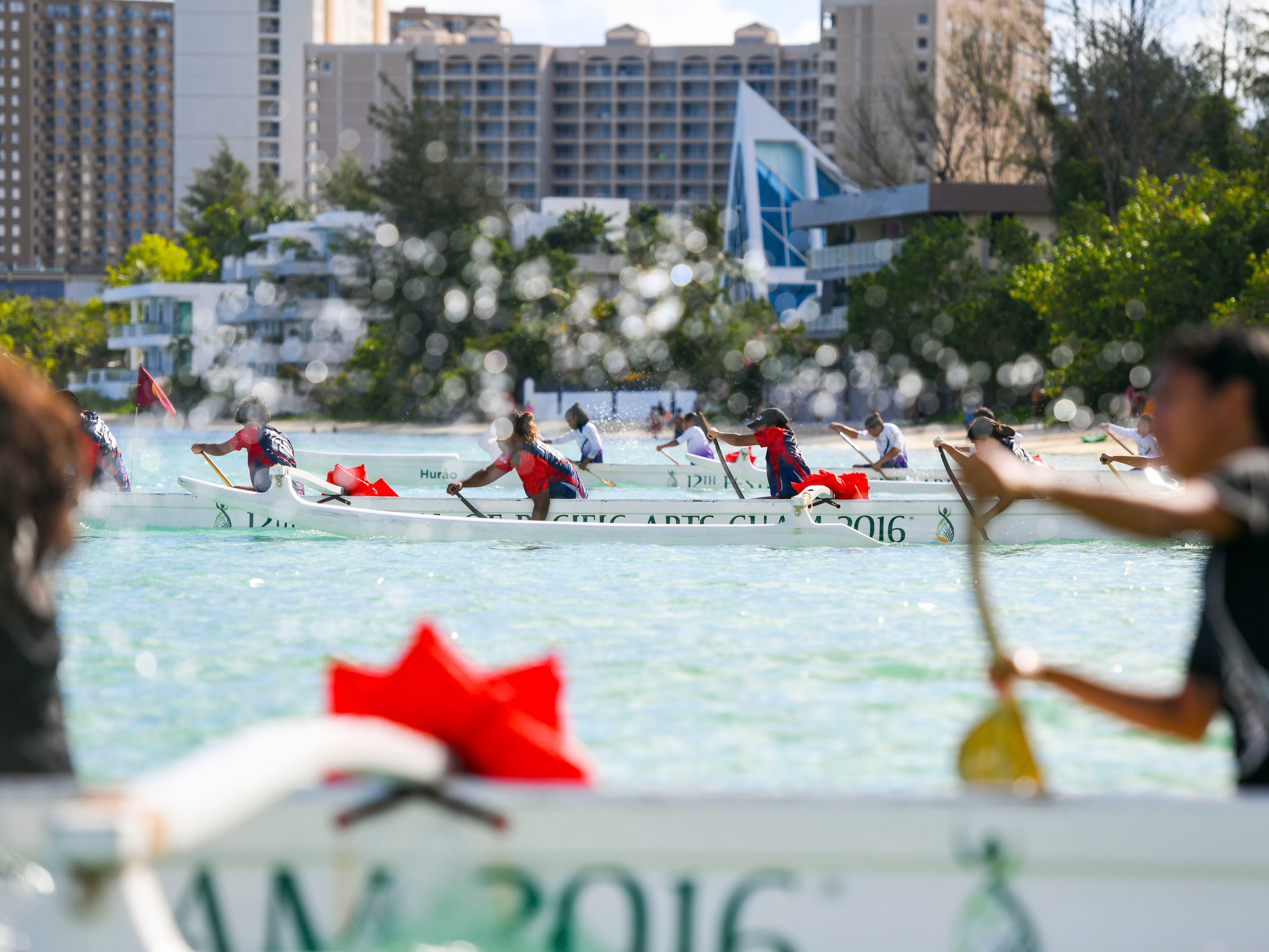 High school paddlers kick off from the starting line during a 1000m mixed manhoben preliminary race in IIAAG Paddling competition at Matapang Beach in Tumon on Saturday, May 11, 2019.