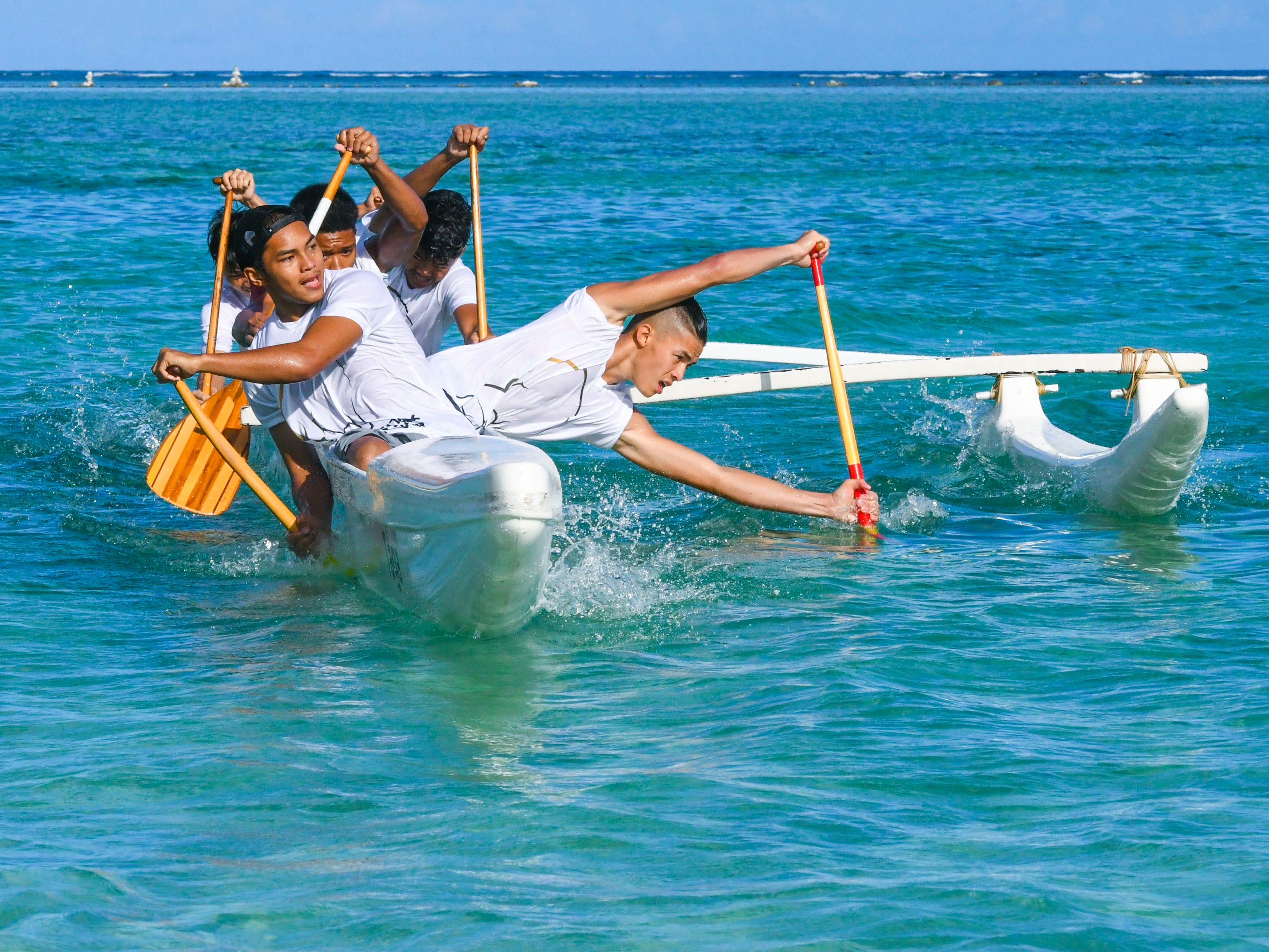 Paddlers from Tiyan High School turn their canoe as they compete against other teams in the waters off Matapang Beach during an IIAAG Paddling competition preliminary race in Tumon on Saturday, May 11, 2019.