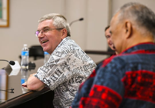 A moment of humor overcomes Thomas Bach, International Olympic Committee president, and others as he entertains questions from the media during a press conference held at the Guam National Olympic Committee office in Maite May 11.