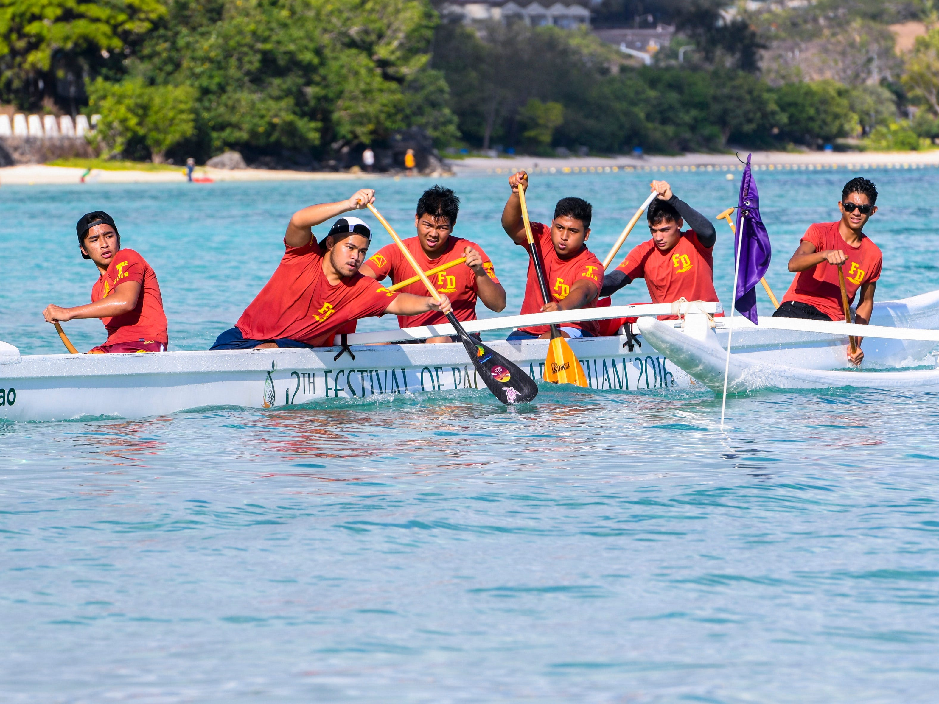 Father Duenas Friars paddlers power their way into a turn during a 1000m mixed manhoben preliminary race in IIAAG Paddling competition at Matapang Beach in Tumon on Saturday, May 11, 2019.