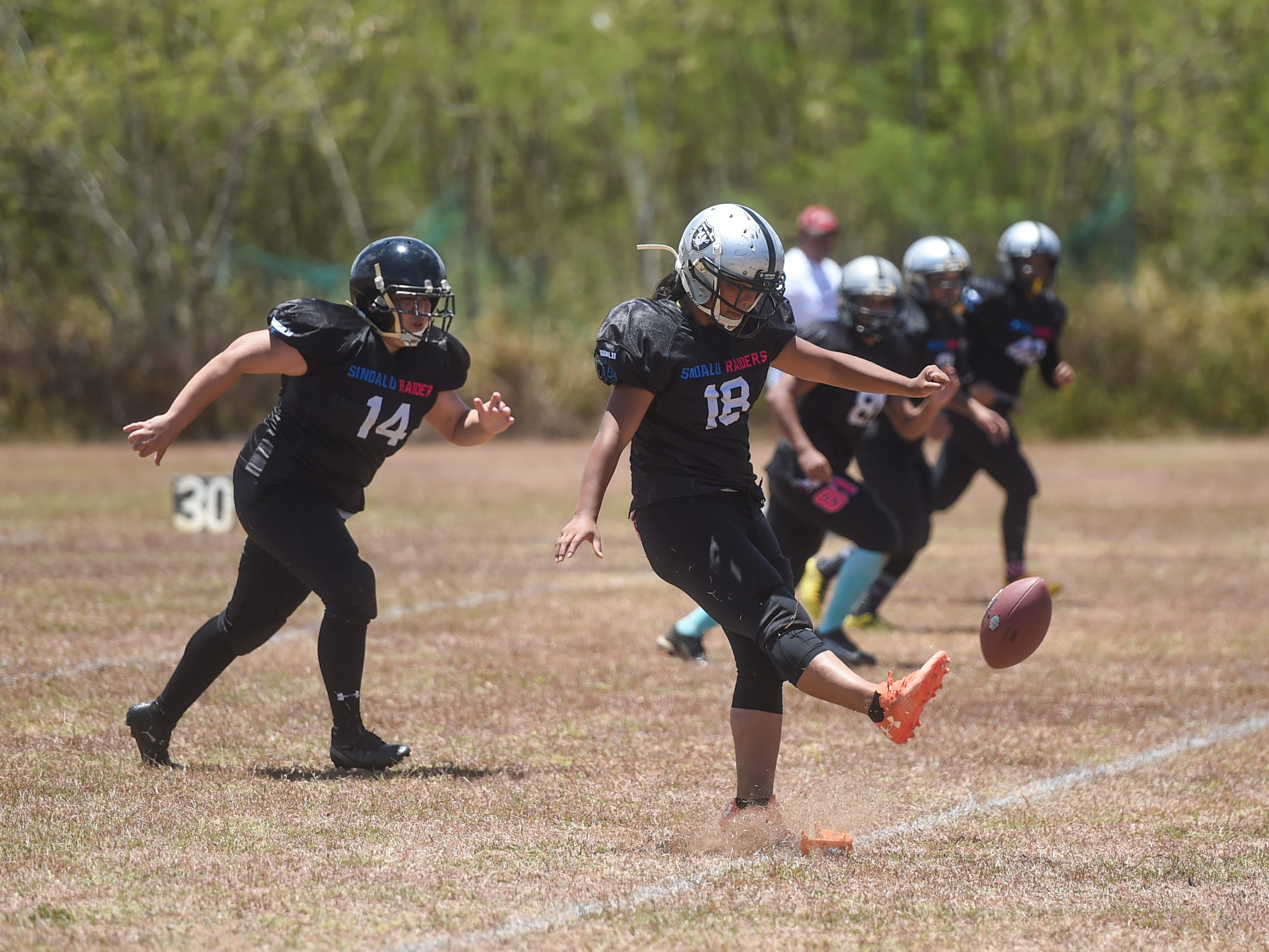 Sindalu/Raiders player Leticia Blas (18) during a kickoff in her 2019 Bud Light GWTFL game against Legacy at the University of Guam Field in Mangilao, May 11, 2019. Legacy came away with a 20-0 victory for their second game of the season.