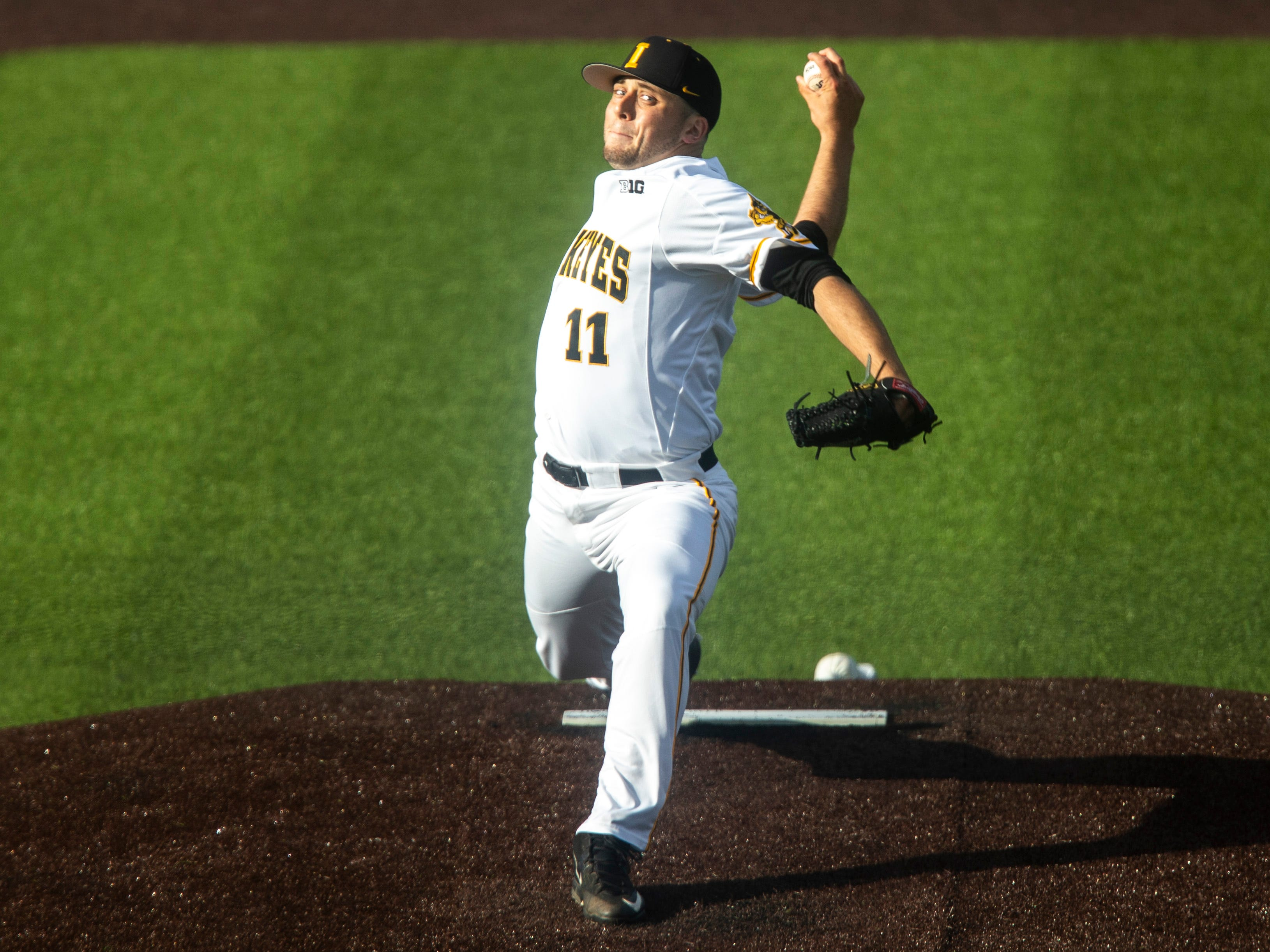 Iowa's Cole McDonald (11) delivers a pitch during a NCAA Big Ten Conference baseball game, Friday, May 10, 2019, at Duane Banks Field on the University of Iowa campus in Iowa City, Iowa.