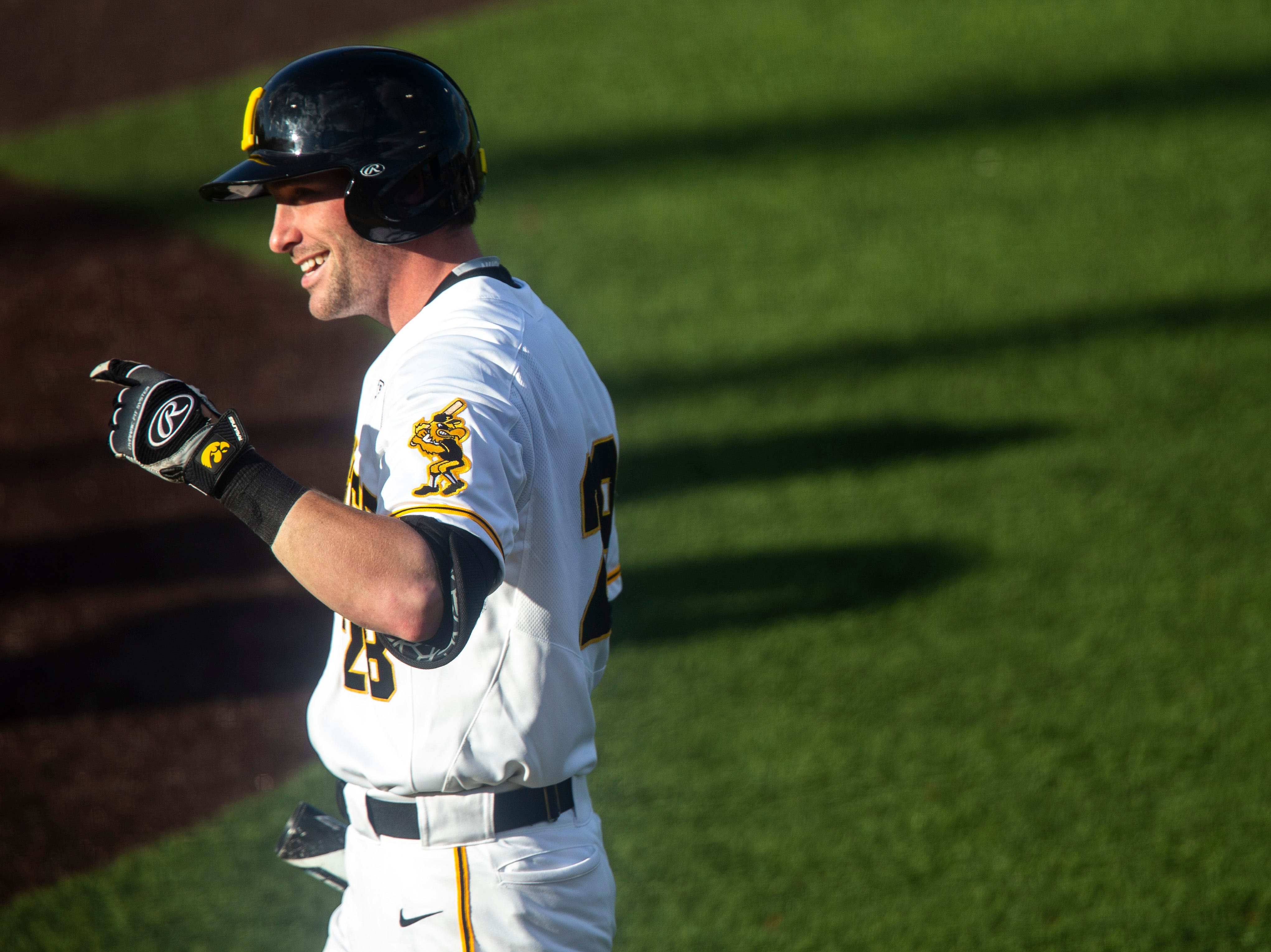 Iowa's Chris Whelan (28) smiles while walking up to the plate during a NCAA Big Ten Conference baseball game, Friday, May 10, 2019, at Duane Banks Field on the University of Iowa campus in Iowa City, Iowa.