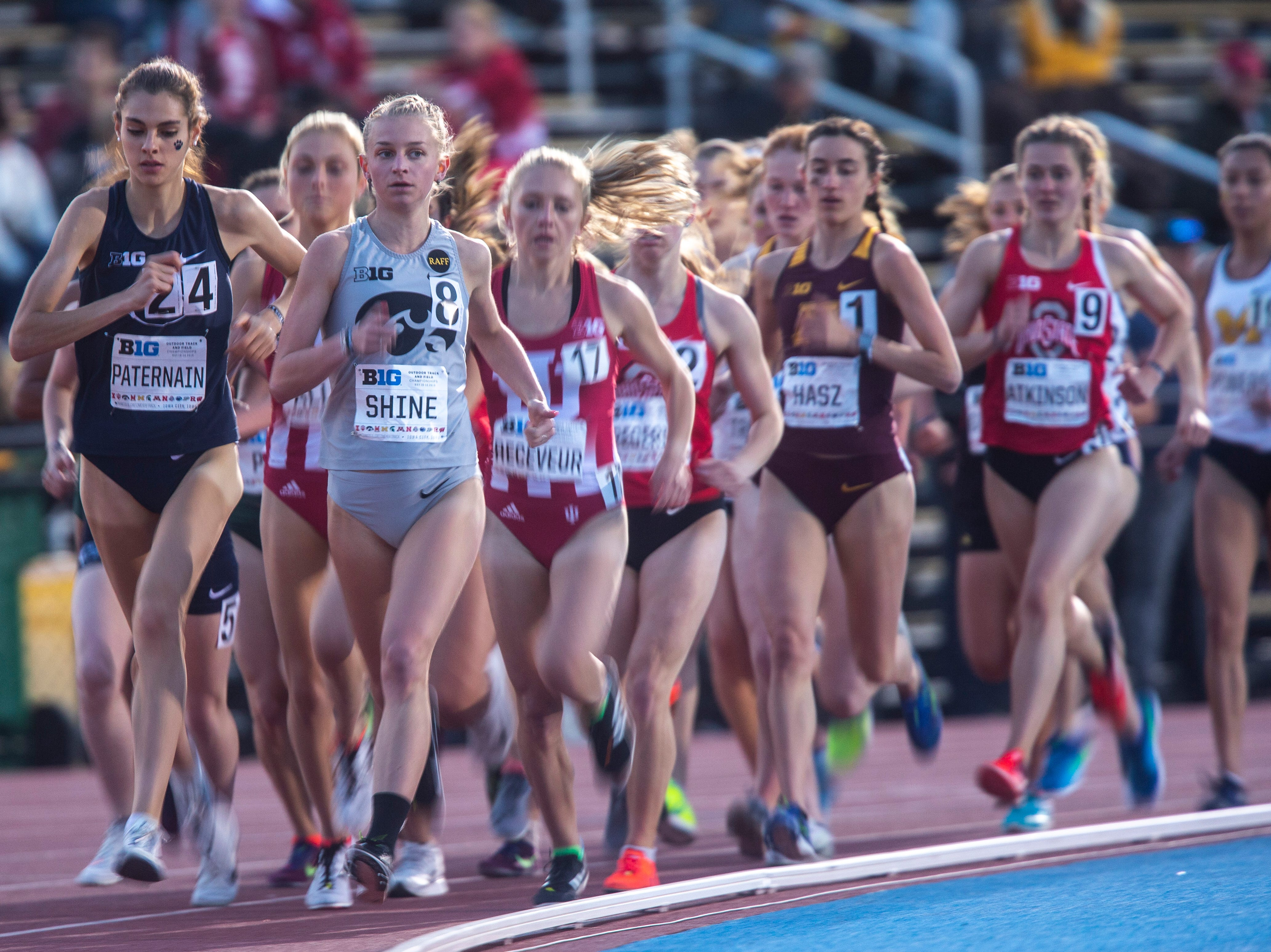 Iowa senior Andrea Shine (8) leads the pack while competing in the 10,000 meters during the first night of Big Ten track and field outdoor championships, Friday, May 10, 2019, at Francis X. Cretzmeyer Track on the University of Iowa campus in Iowa City, Iowa. Indiana senior Margaret Allen finished with a time of 33:08.59.