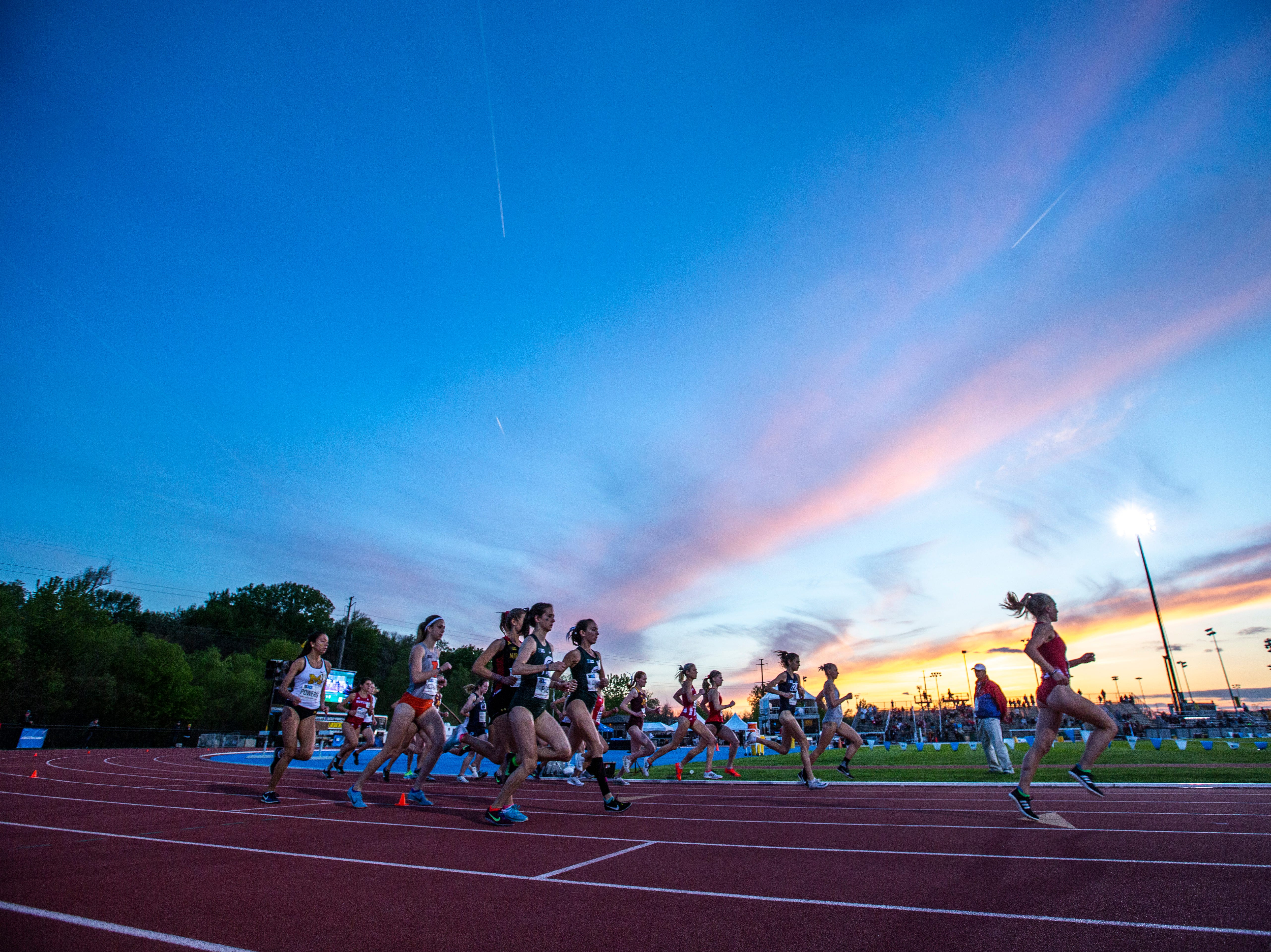 Indiana redshirt senior Katherine Receveur leads the pack in the women's 10,000 meter during the first night of Big Ten track and field outdoor championships, Friday, May 10, 2019, at Francis X. Cretzmeyer Track on the University of Iowa campus in Iowa City, Iowa. Indiana senior Margaret Allen finished with a time of 33:08.59.
