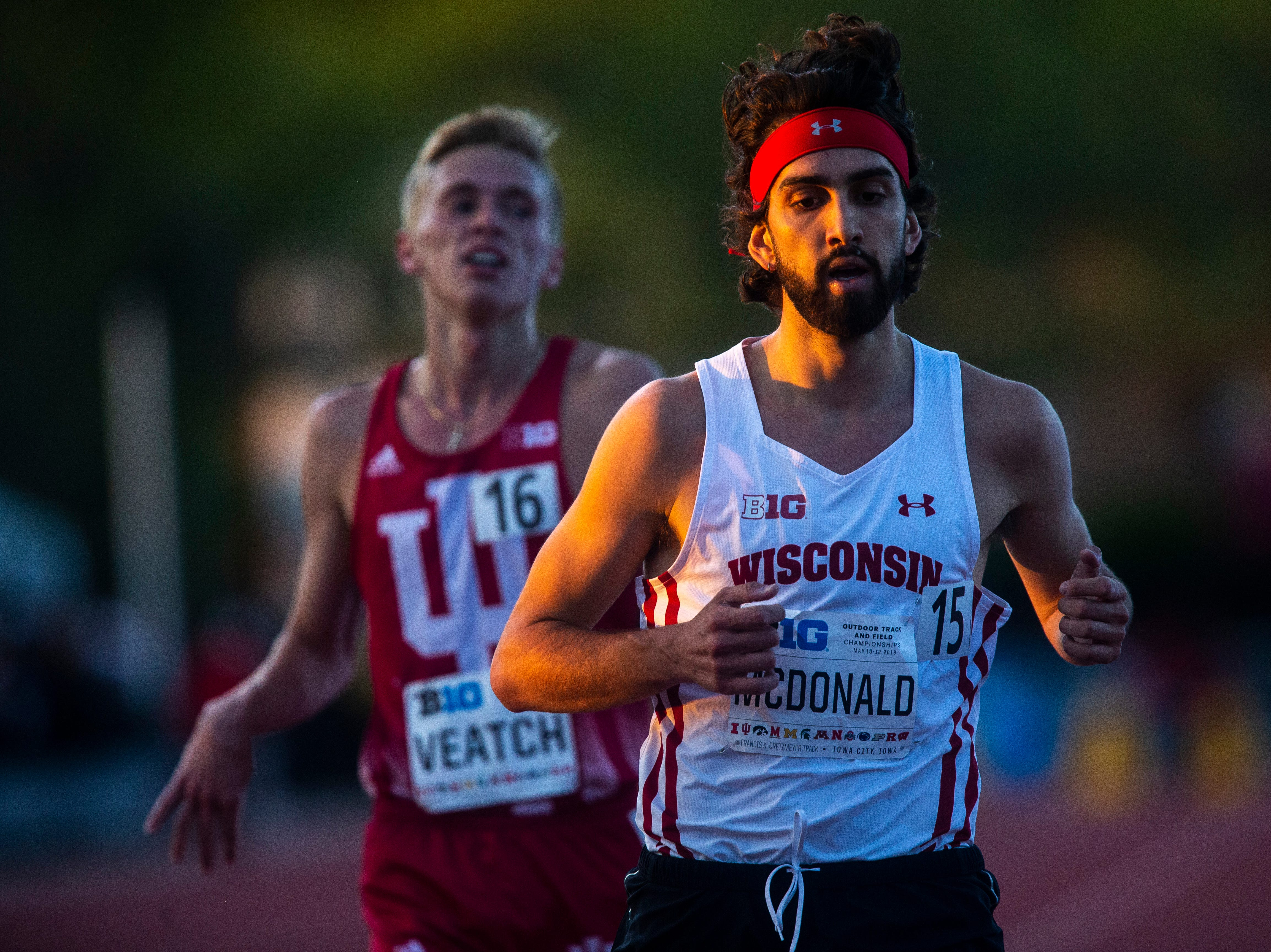 Wisconsin senior Morgan McDonald crosses the finish line ahead of Indiana redshirt sophomore Ben Veatch in the 10,000 meter during the first night of Big Ten track and field outdoor championships, Friday, May 10, 2019, at Francis X. Cretzmeyer Track on the University of Iowa campus in Iowa City, Iowa. McDonald finished with a time of 29:26.06.