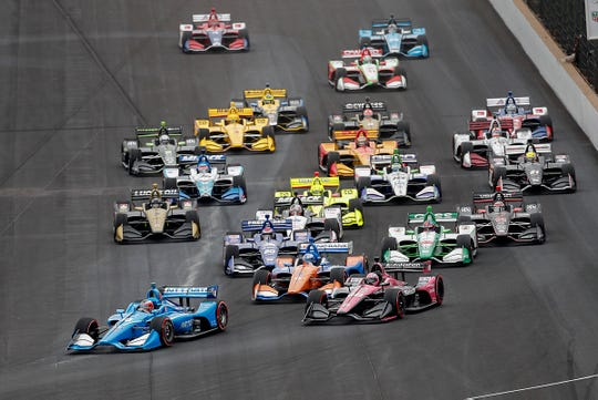 May 11, 2019: The field of 24 IndyCars lead by Chip Ganassi Racing driver Felix Rosenqvist (10) drives into turn one on the first lap of the IndyCar Grand Prix at the Indianapolis Motor Speedway