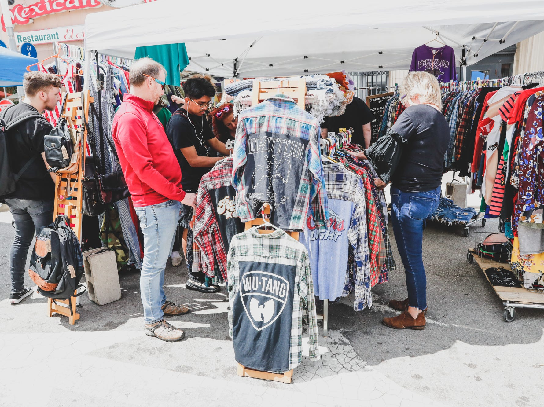 Guests shop at the Reclaim and Rethread booth during the Virginia Avenue Music Fest, held in Fountain Square, located in Indianapolis, on Saturday, May 11, 2019.