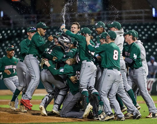 The Lawrence North Wildcats celebrate their 3-0 win over Perry Meridian during Marion County tournament championships at Victory Field in Indianapolis, Friday, May 10, 2019. It's the team's first title since 1995.