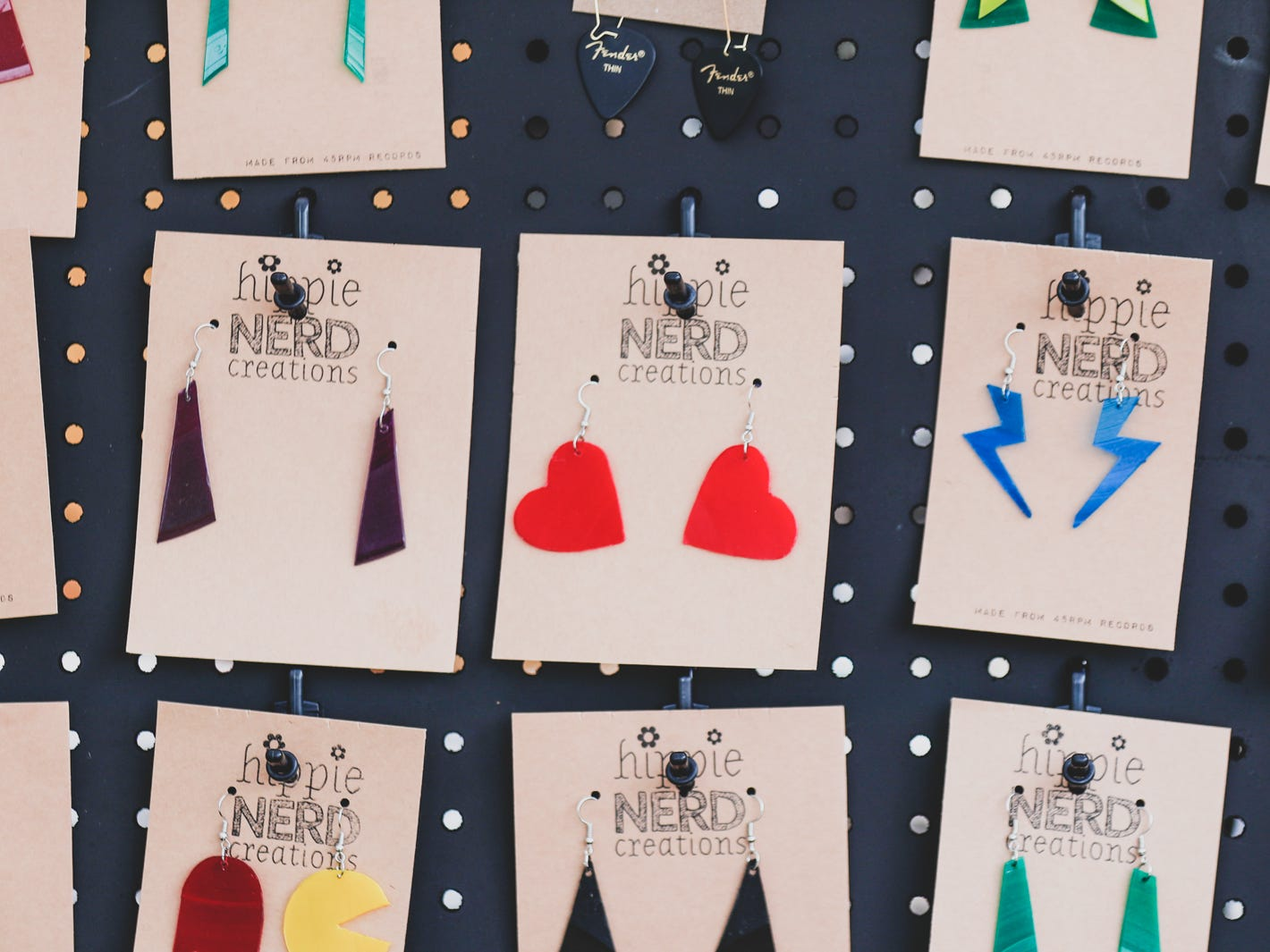 Up-cycled vinyl record earrings are sold in the Hippy Nerd Creations booth, during the Virginia Avenue Music Fest, held in Fountain Square, located in Indianapolis, on Saturday, May 11, 2019.