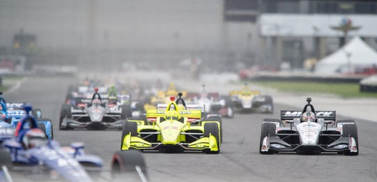 The field of cars race into turn 7 during the running of the IndyCar Grand Prix on the road coarse at the Indianapolis Motor Speedway, Saturday, May 11, 2019.