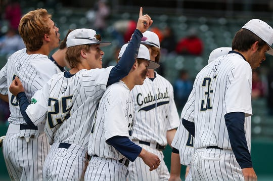 The Cathedral Fighting Irish celebrate after defeating Covenant Christian, 2-0, for the city tournament title at Victory Field in Indianapolis, Friday, May 10, 2019.