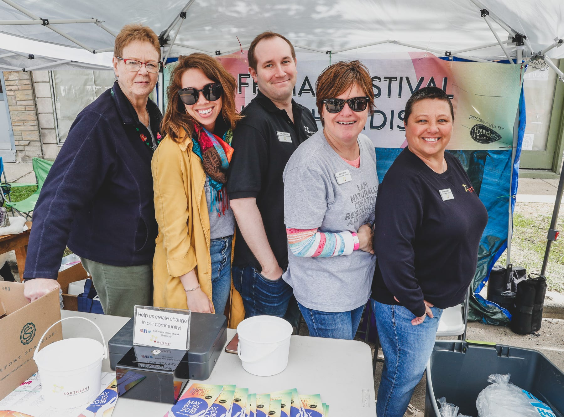 Representatives from Southeast Community Services, Inc. pose for a photo during the Virginia Avenue Music Fest, held in Fountain Square, located in Indianapolis, on Saturday, May 11, 2019. Funds raised by this years VAMF support the Southeast Community Services, Inc.