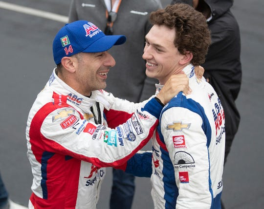 A.J. Foyt Enterprises driver Tony Kanaan congratulates his teamamte Matheus Leist with his 4th place finish in the IndyCar Grand Prix at the Indianapolis Motor Speedway on Saturday, May 11, 2019.