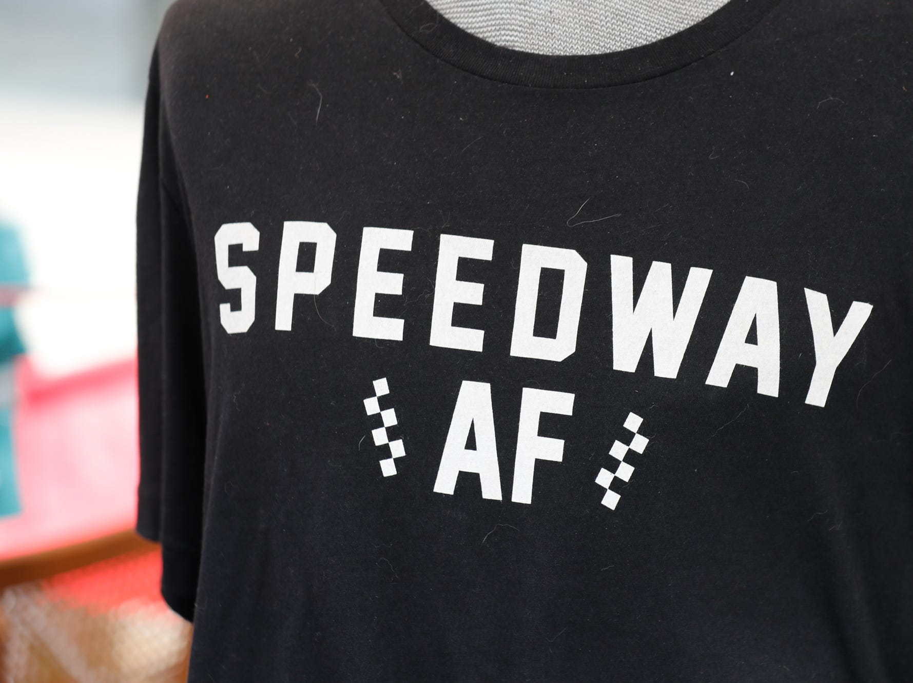 A racing themed T-shirt is for sale in the Queen Bee Vintage booth, during the Virginia Avenue Music Fest, held in Fountain Square, located in Indianapolis, on Saturday, May 11, 2019.