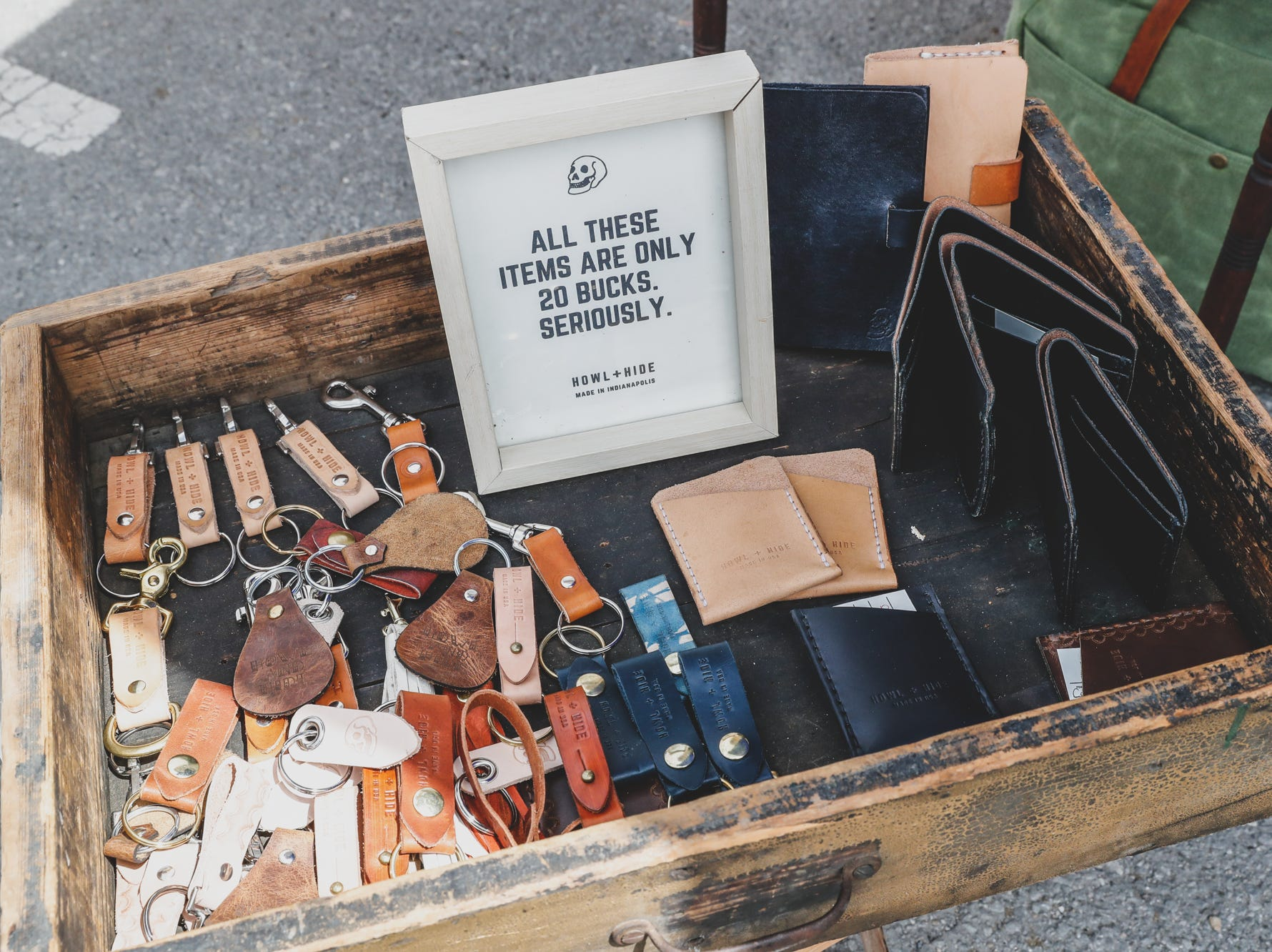 Leather and canvass goods are sold in the Howl + Hide booth during the Virginia Avenue Music Fest, held in Fountain Square, located in Indianapolis, on Saturday, May 11, 2019.