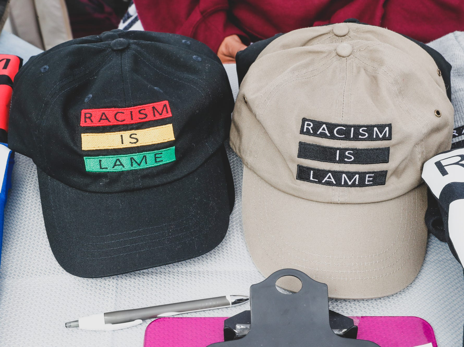 "Dana Howard, and Twana Lipscomb sell shirts and hats with their ""Racism Is Lame"" logo, during the Virginia Avenue Music Fest, held in Fountain Square, located in Indianapolis, on Saturday, May 11, 2019."