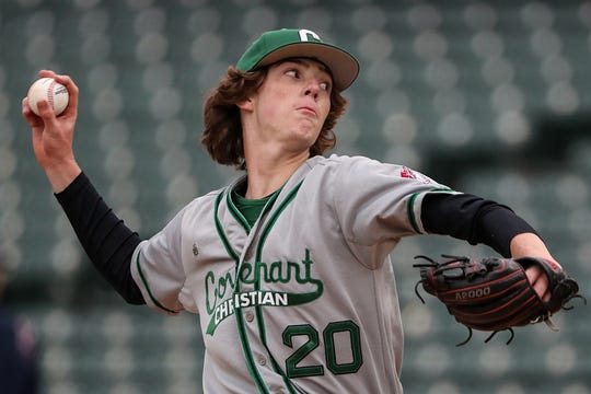 Covenant Christian's Brock Buckley (20) pitches during city tournament championships at Victory Field in Indianapolis, Friday, May 10, 2019. Cathedral won, 2-0.