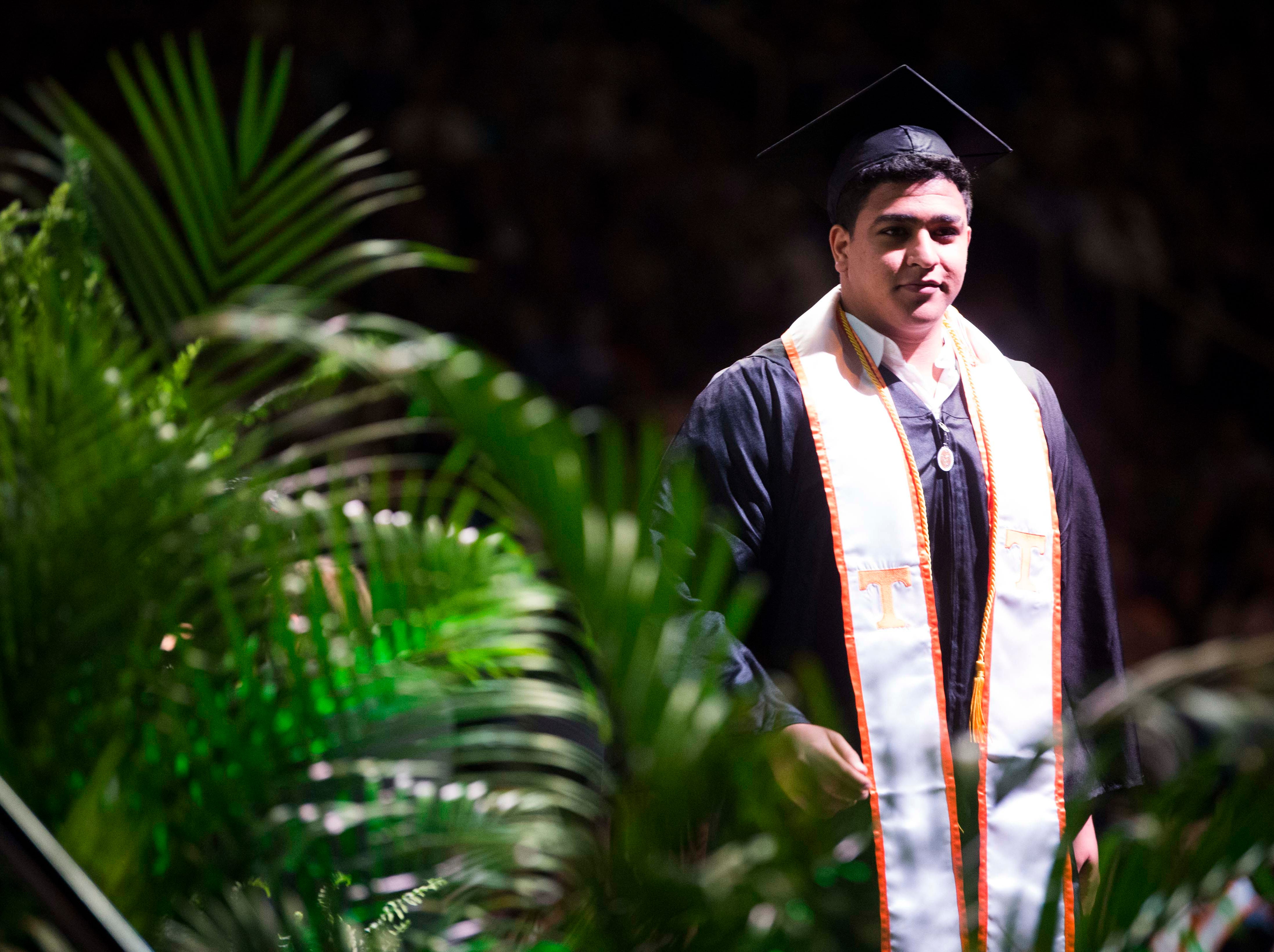 A student walks across the stage during University of Tennessee's College of Arts and Sciences commencement in Thompson-Boling arena in Knoxville, Saturday, May 11, 2019.