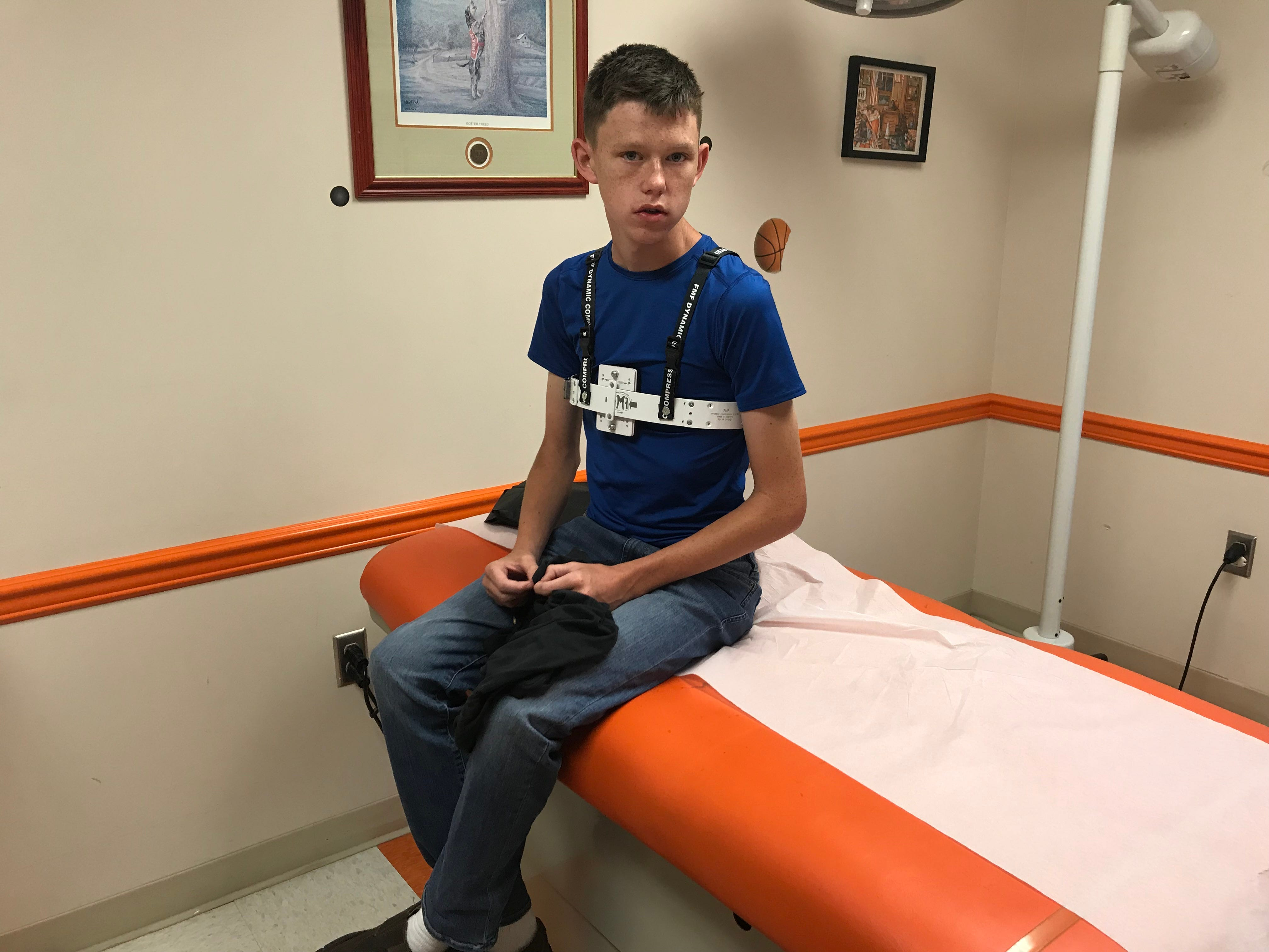"""At East Tennessee Children's Hospital's new chest wall clinic, Tinsley Allen tries on a new custom brace designed to correct his """"pigeon chest."""""""