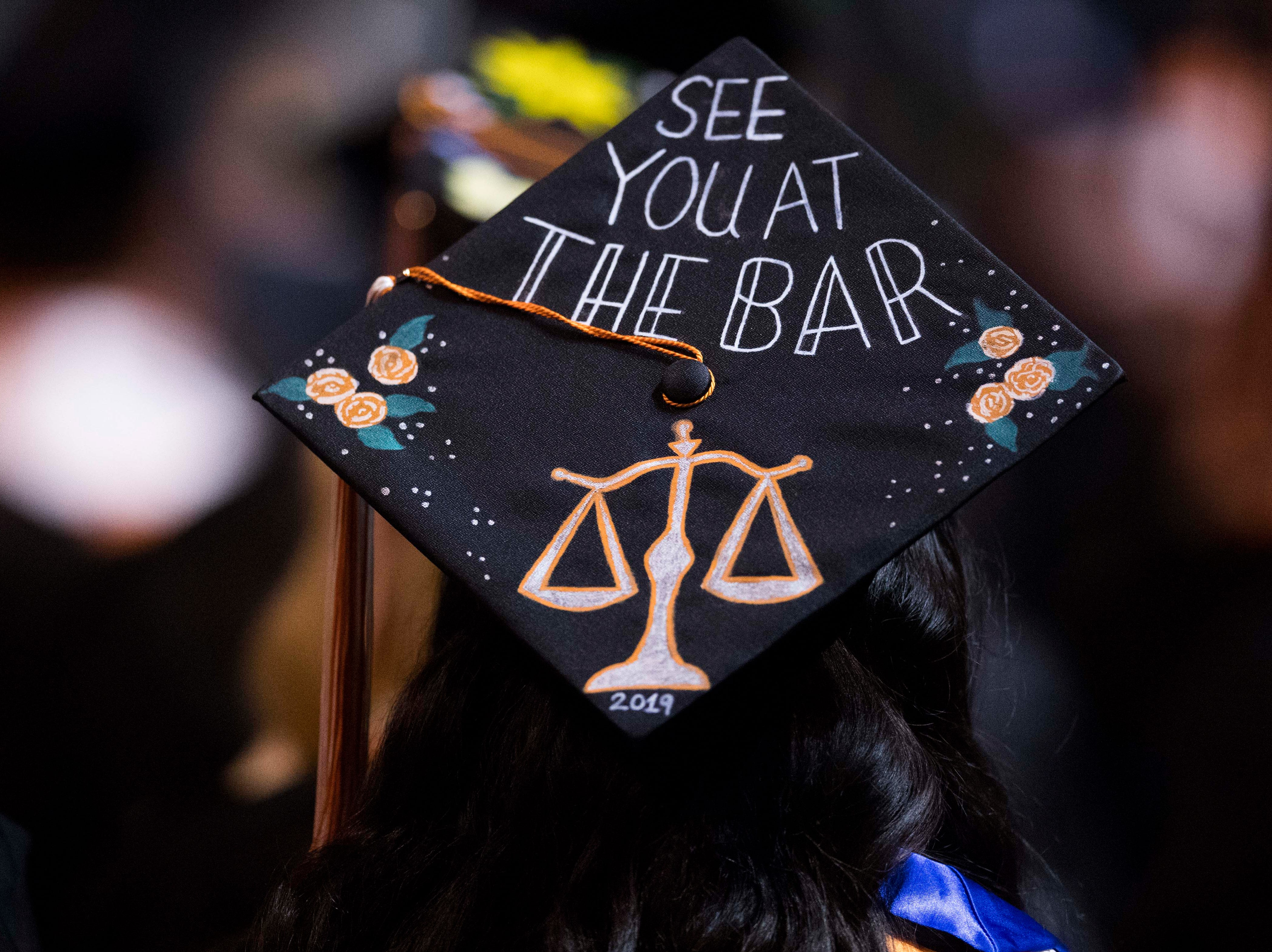 A decorated graduation cap is seen during University of Tennessee's College of Arts and Sciences commencement in Thompson-Boling arena in Knoxville, Saturday, May 11, 2019.