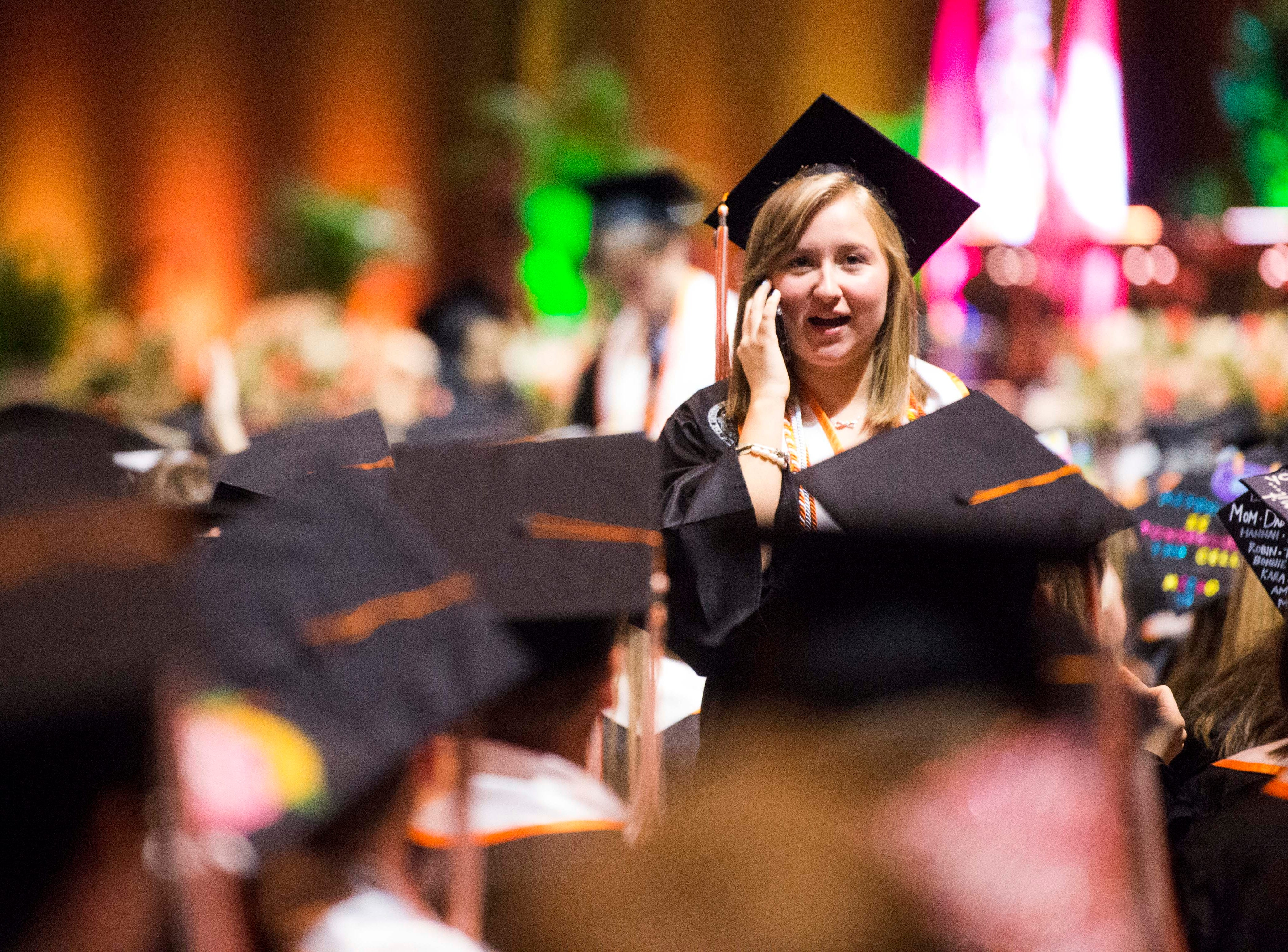 Students wait before University of Tennessee's College of Arts and Sciences commencement in Thompson-Boling arena in Knoxville, Saturday, May 11, 2019.