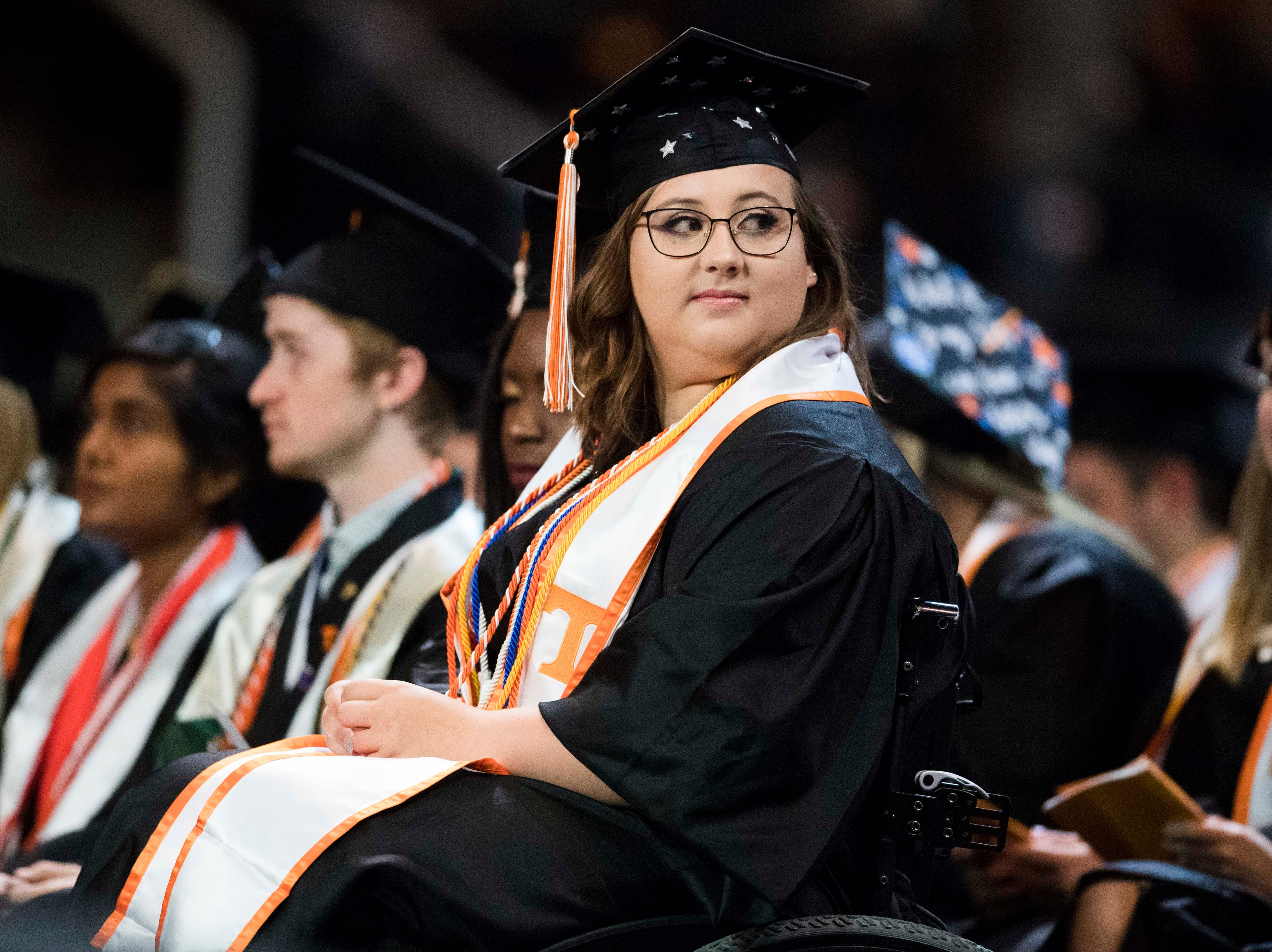 A student listens during University of Tennessee's College of Arts and Sciences commencement in Thompson-Boling arena in Knoxville, Saturday, May 11, 2019.