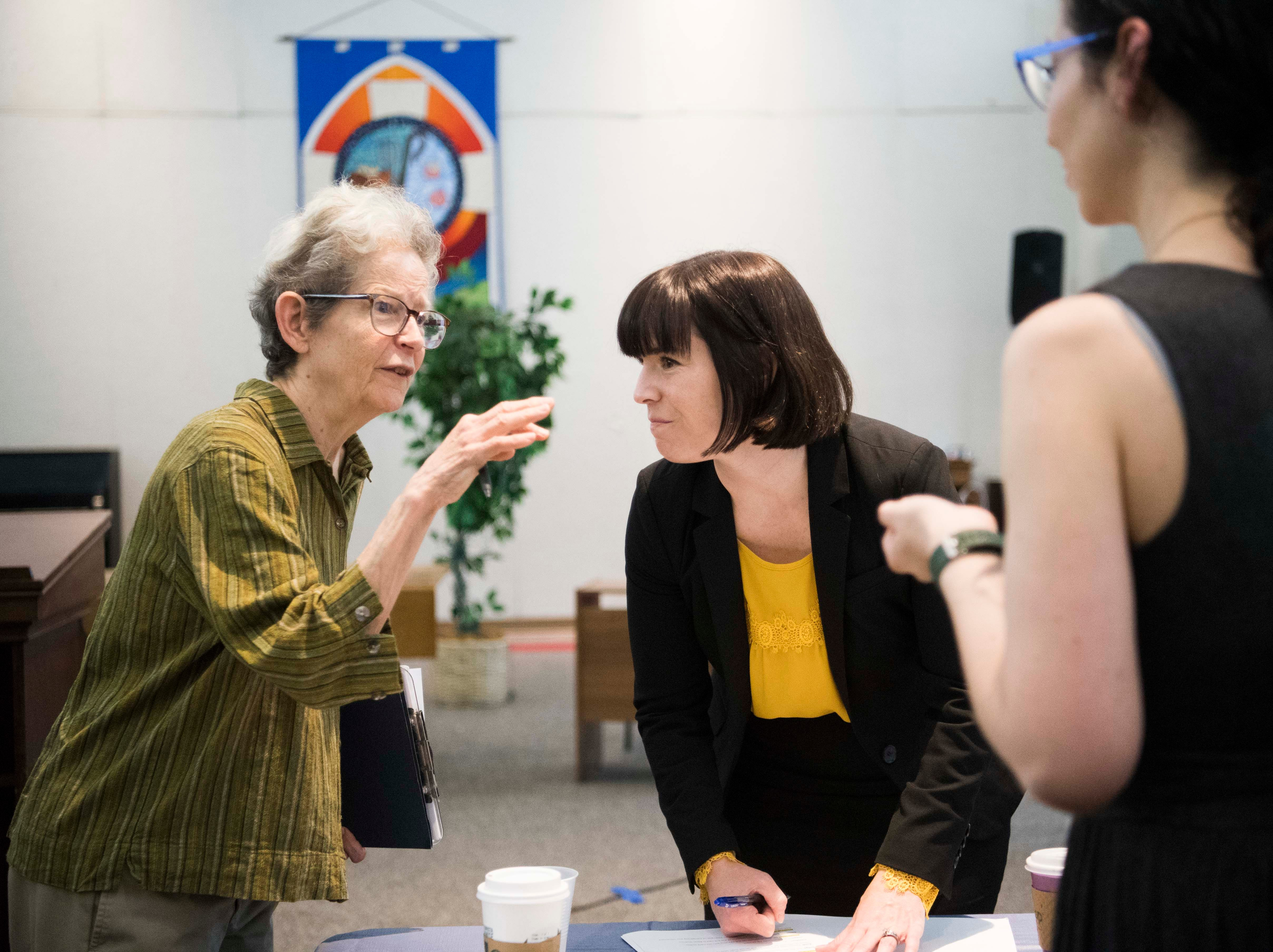 At left Fran Ansley speaks with Christine Ball-Blakely before a mock trial put on by Allies of Knoxville's Immigrant Neighbors, AKIN, at St. James Episcopal Church of Knoxville in Knoxville, Saturday, May 11, 2019. The court was part of the group's efforts to raise awareness about the negative effects of Knox County's 287(g) program, the only program of its kind in the state, which trains local officers to enforce federal immigration laws.