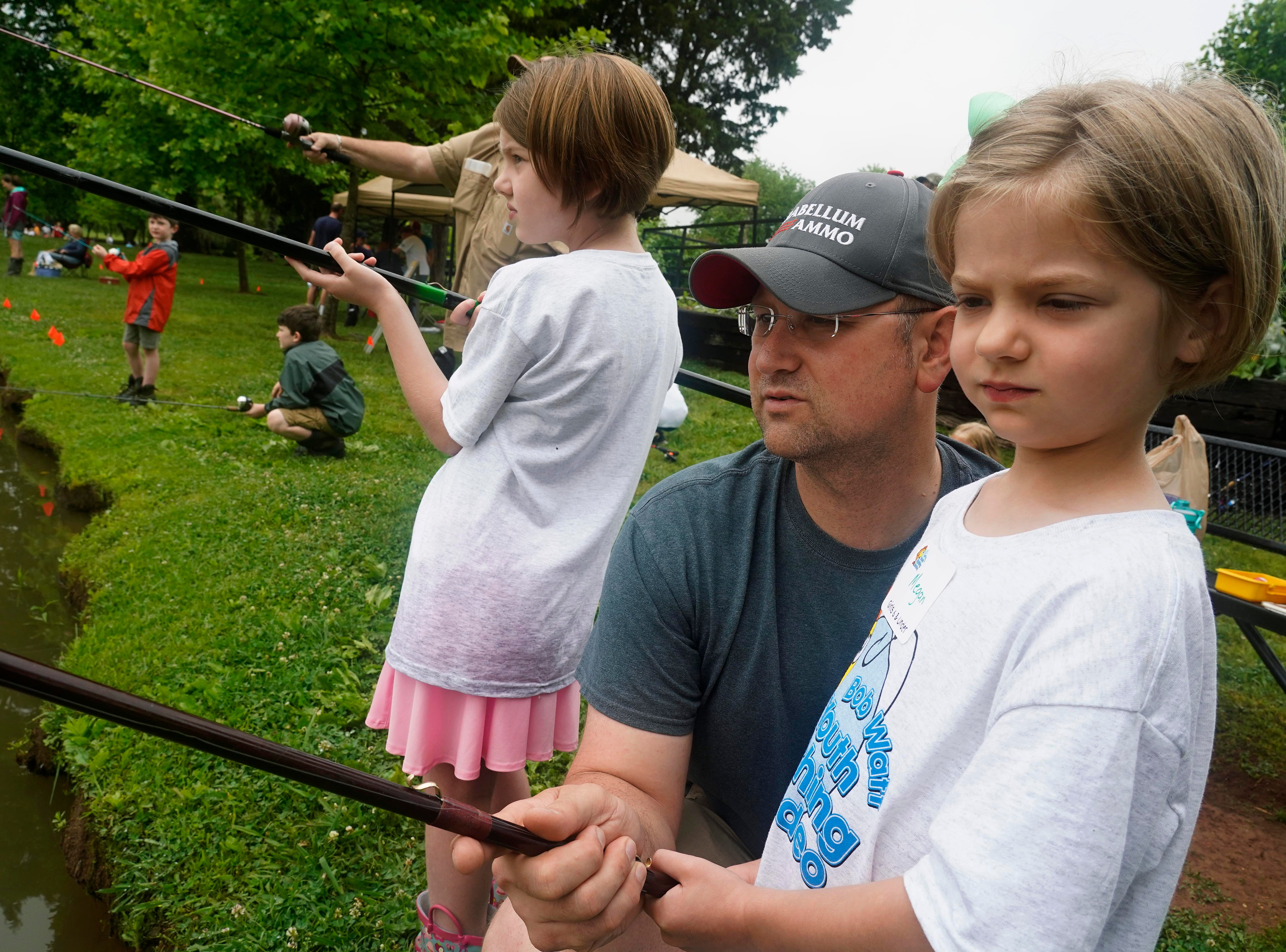 Abigail and Megan fish with their father Ryan Patrick during  the 35th Annual Bob Watt Youth Fishing Rodeo Saturday, May. 11, 2019 at Anchor Park on Turkey Creek Road.