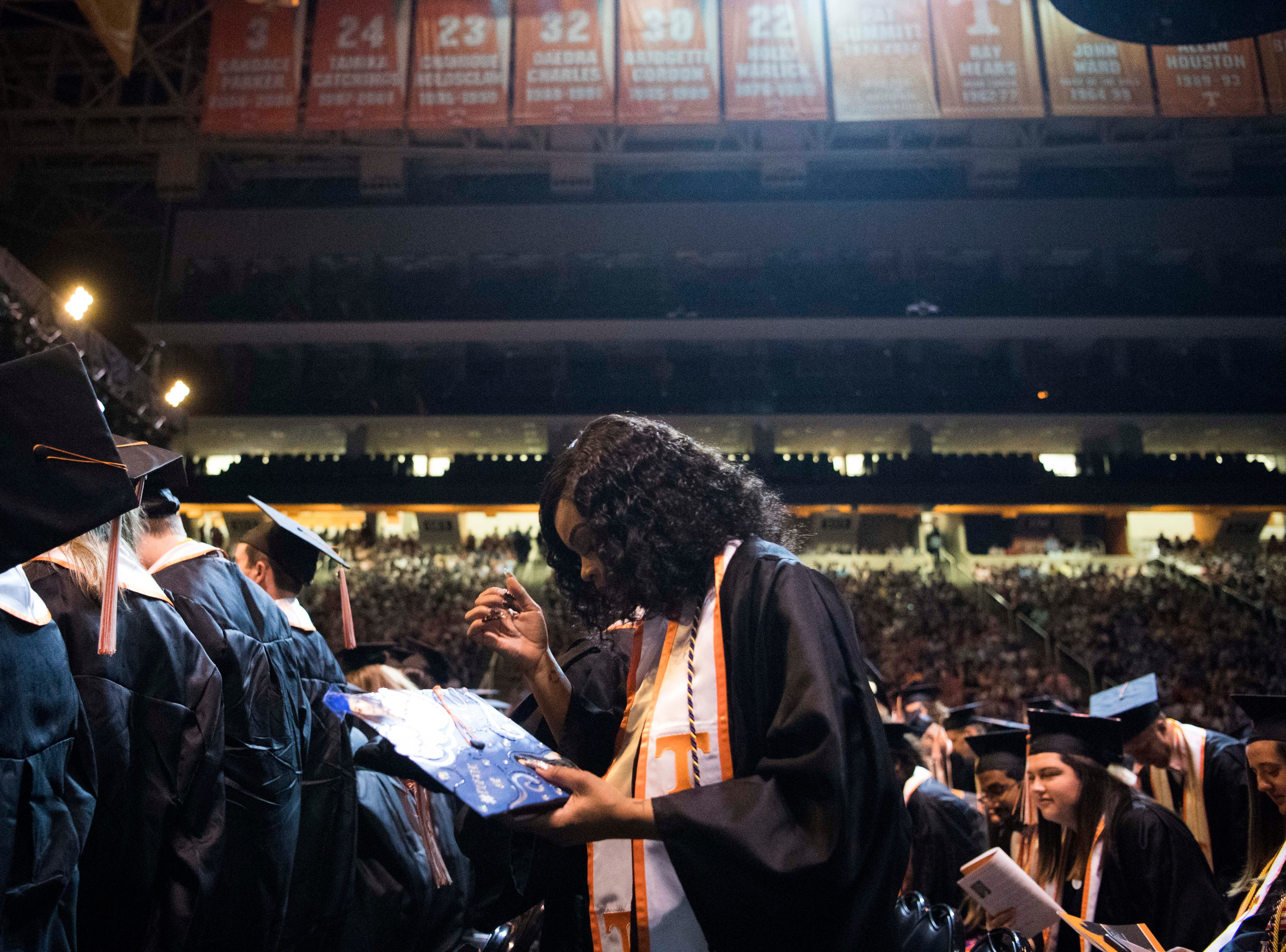 Students stand during University of Tennessee's College of Arts and Sciences commencement in Thompson-Boling arena in Knoxville, Saturday, May 11, 2019.