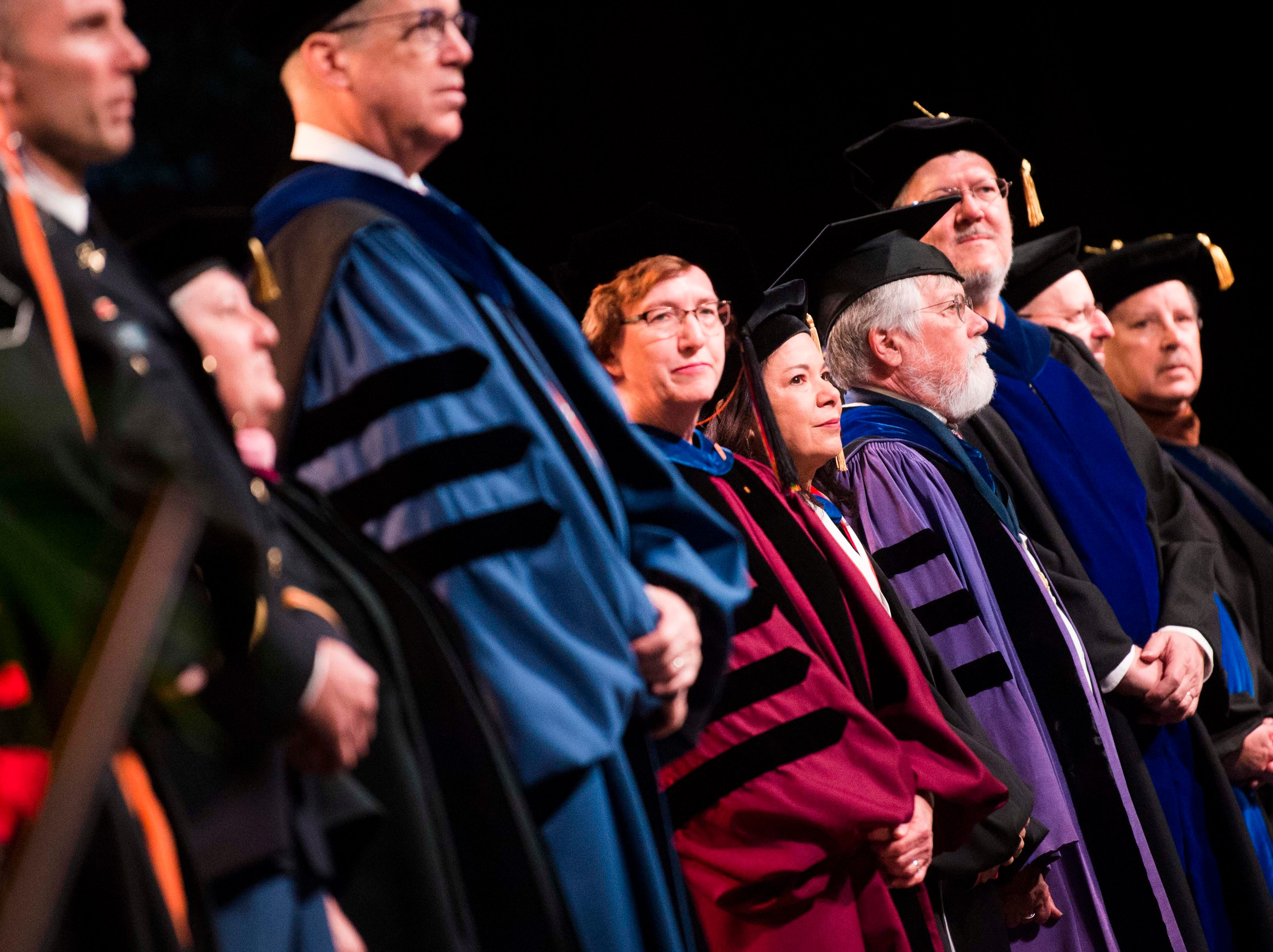 Faculty and staff stand during University of Tennessee's College of Arts and Sciences commencement in Thompson-Boling arena in Knoxville, Saturday, May 11, 2019.