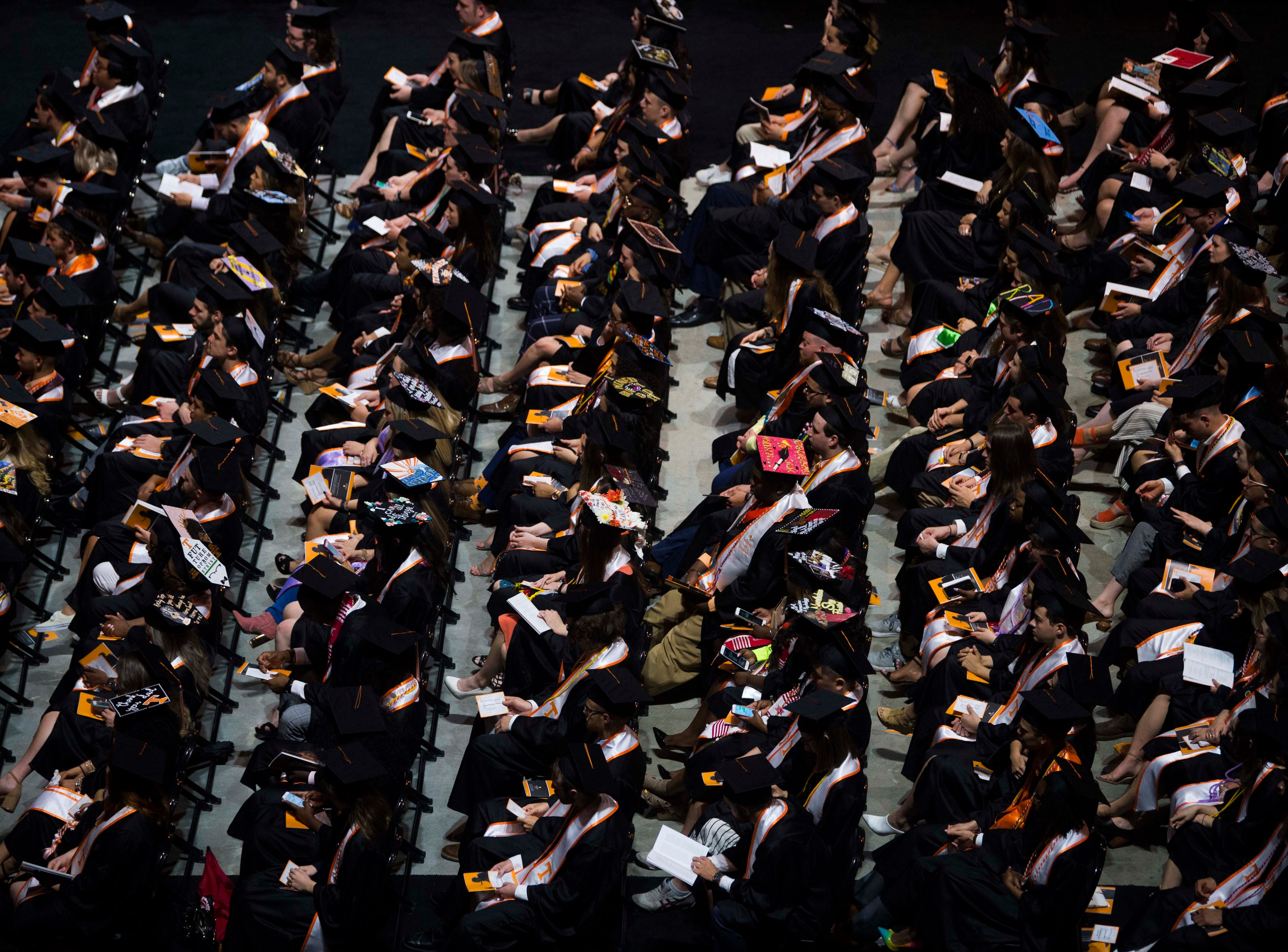 Students are seen during University of Tennessee's College of Arts and Sciences commencement in Thompson-Boling arena in Knoxville, Saturday, May 11, 2019.