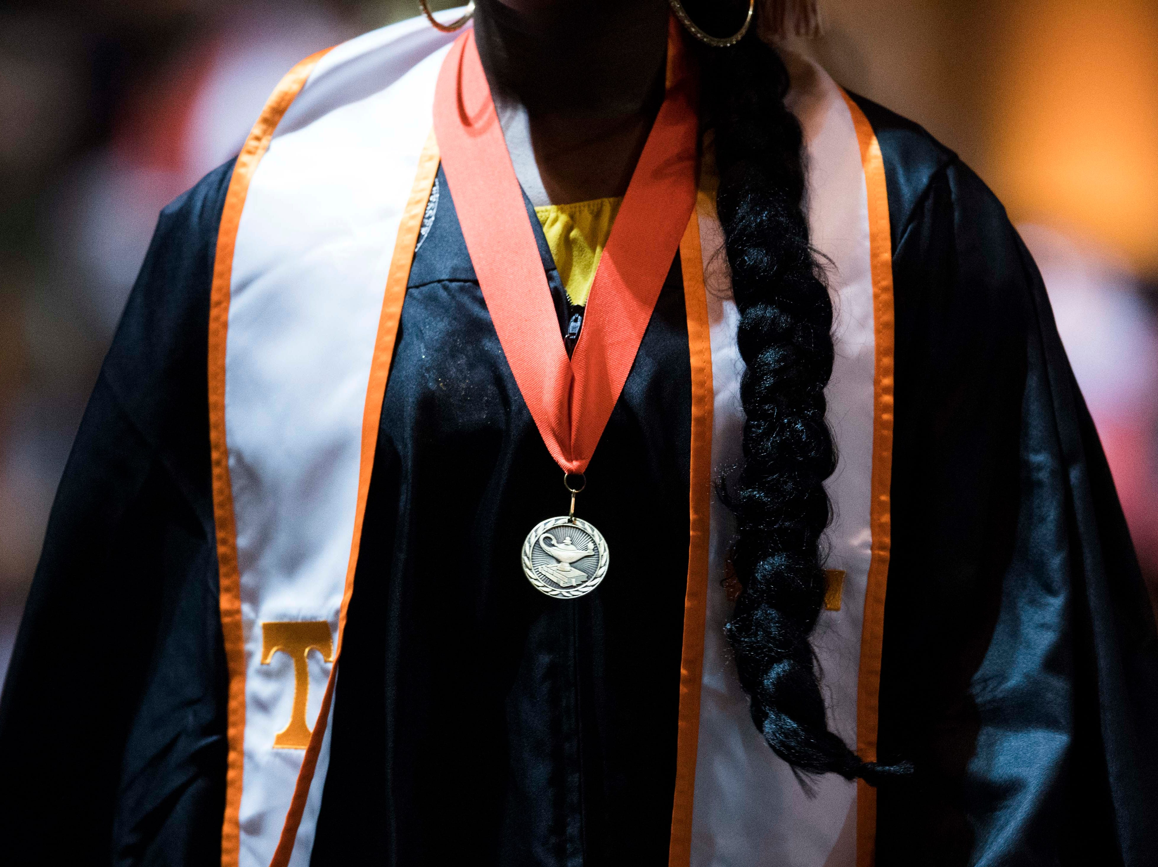A student walks up the aisle after walking across the stage during University of Tennessee's College of Arts and Sciences commencement in Thompson-Boling arena in Knoxville, Saturday, May 11, 2019.