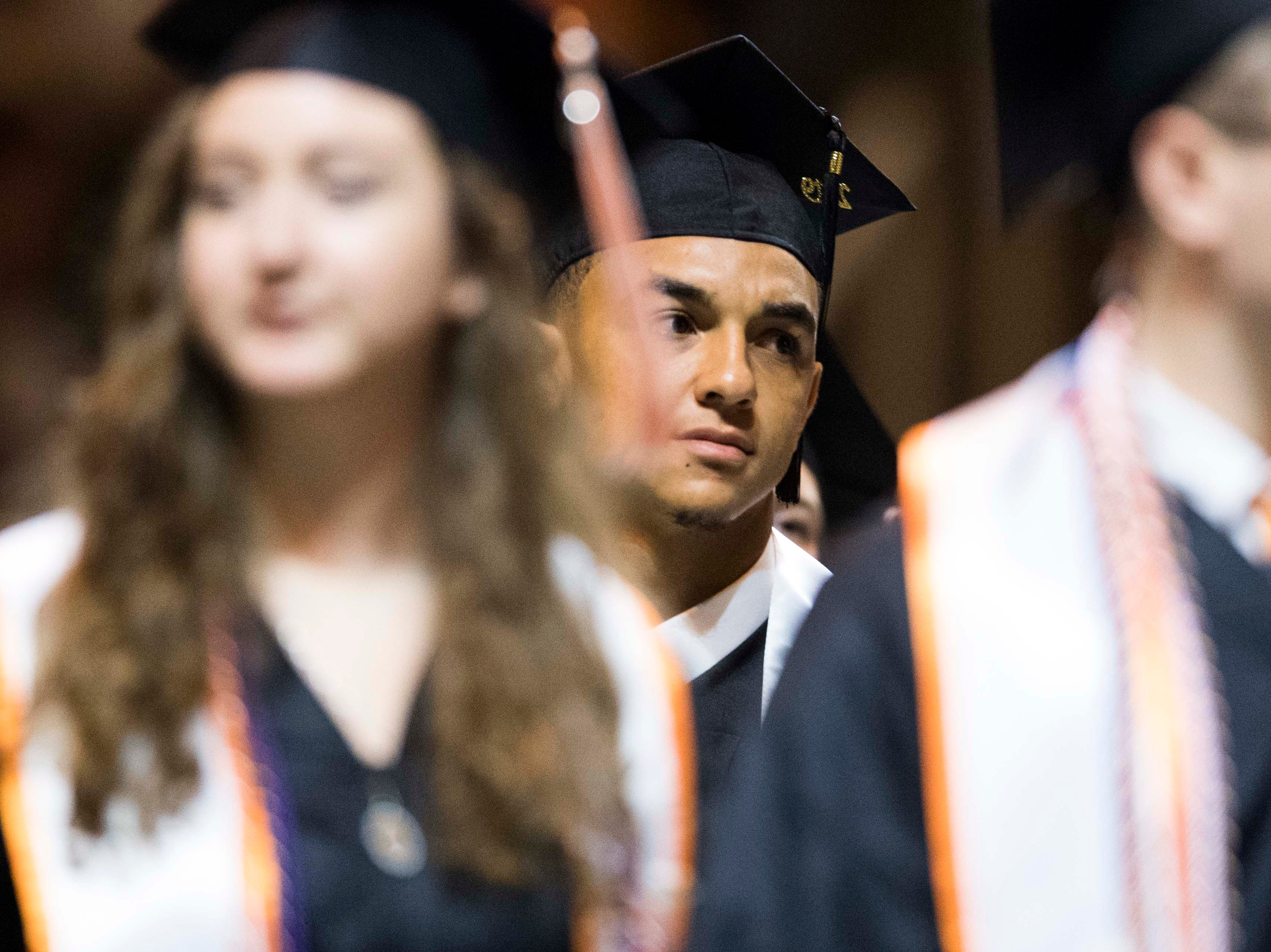 Tennessee quarterback Jarret Guarantano stands with other students after walking across the stage during University of Tennessee's College of Arts and Sciences commencement in Thompson-Boling arena in Knoxville, Saturday, May 11, 2019.