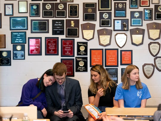 Morristown West students break for lunch in Suzanne Terry's classroom, where awards for her speech and debate program fill the walls.
