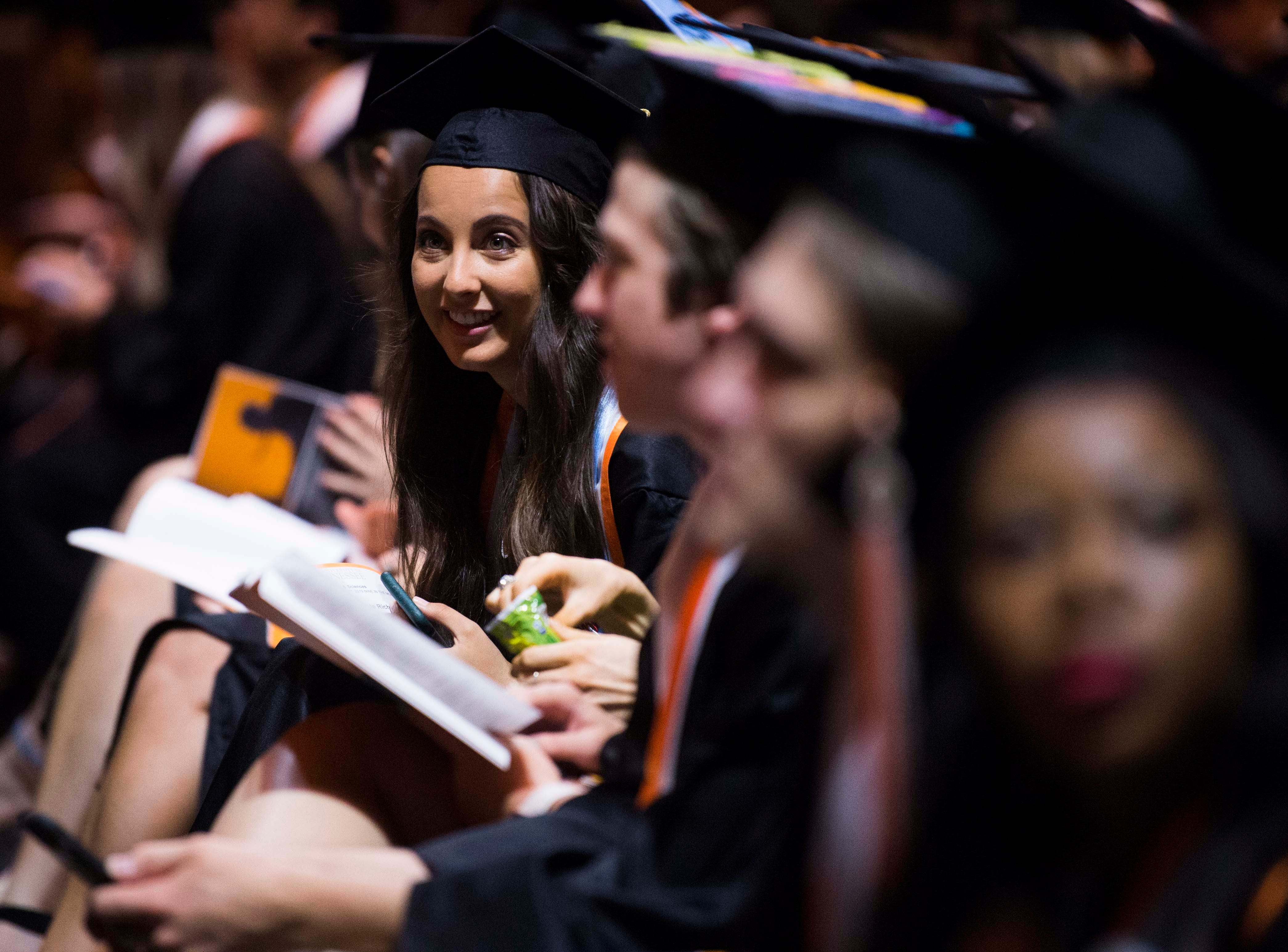 Students listen during University of Tennessee's College of Arts and Sciences commencement in Thompson-Boling arena in Knoxville, Saturday, May 11, 2019.