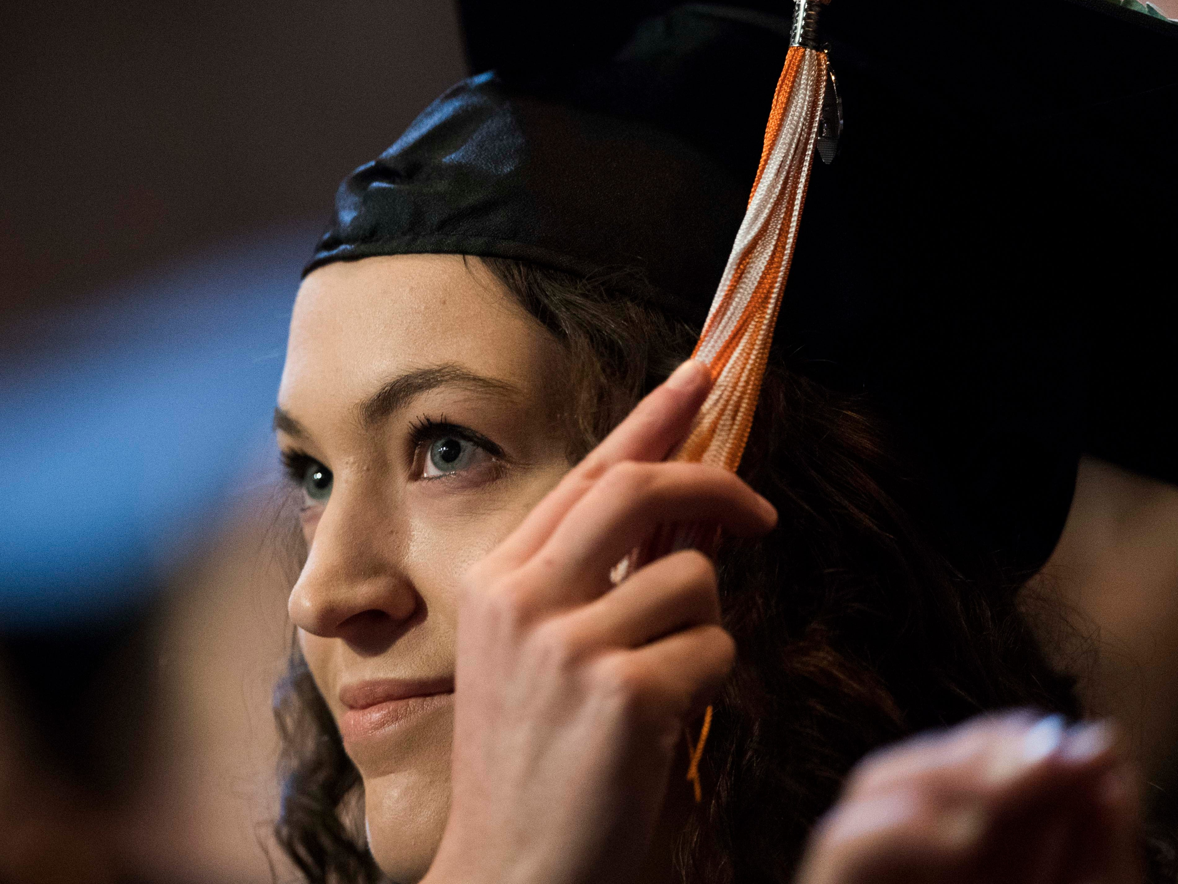 A student turns her tassel during University of Tennessee's College of Arts and Sciences commencement in Thompson-Boling arena in Knoxville, Saturday, May 11, 2019.