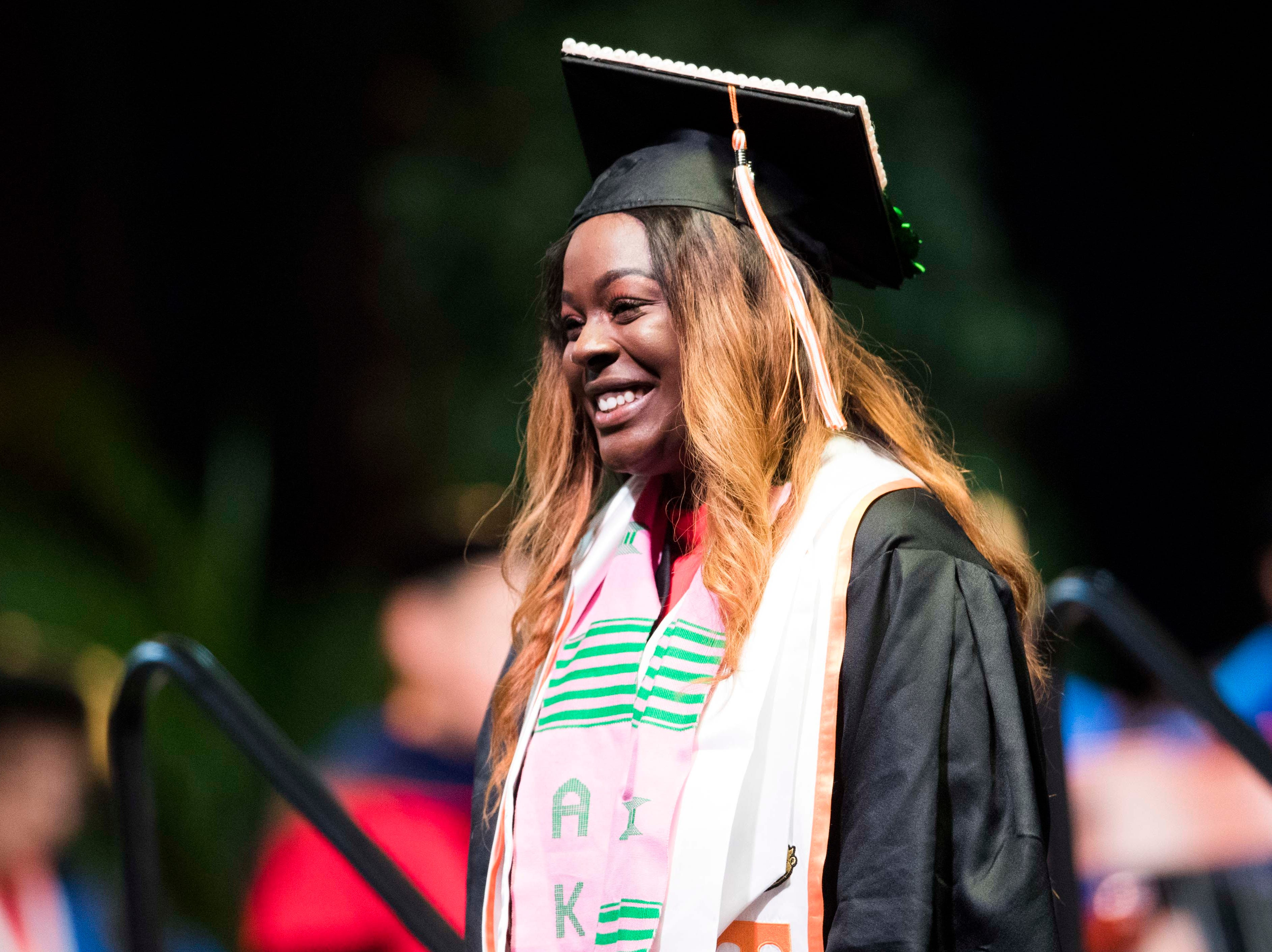 A graduate walks across the stage during University of Tennessee's College of Arts and Sciences commencement in Thompson-Boling arena in Knoxville, Saturday, May 11, 2019.