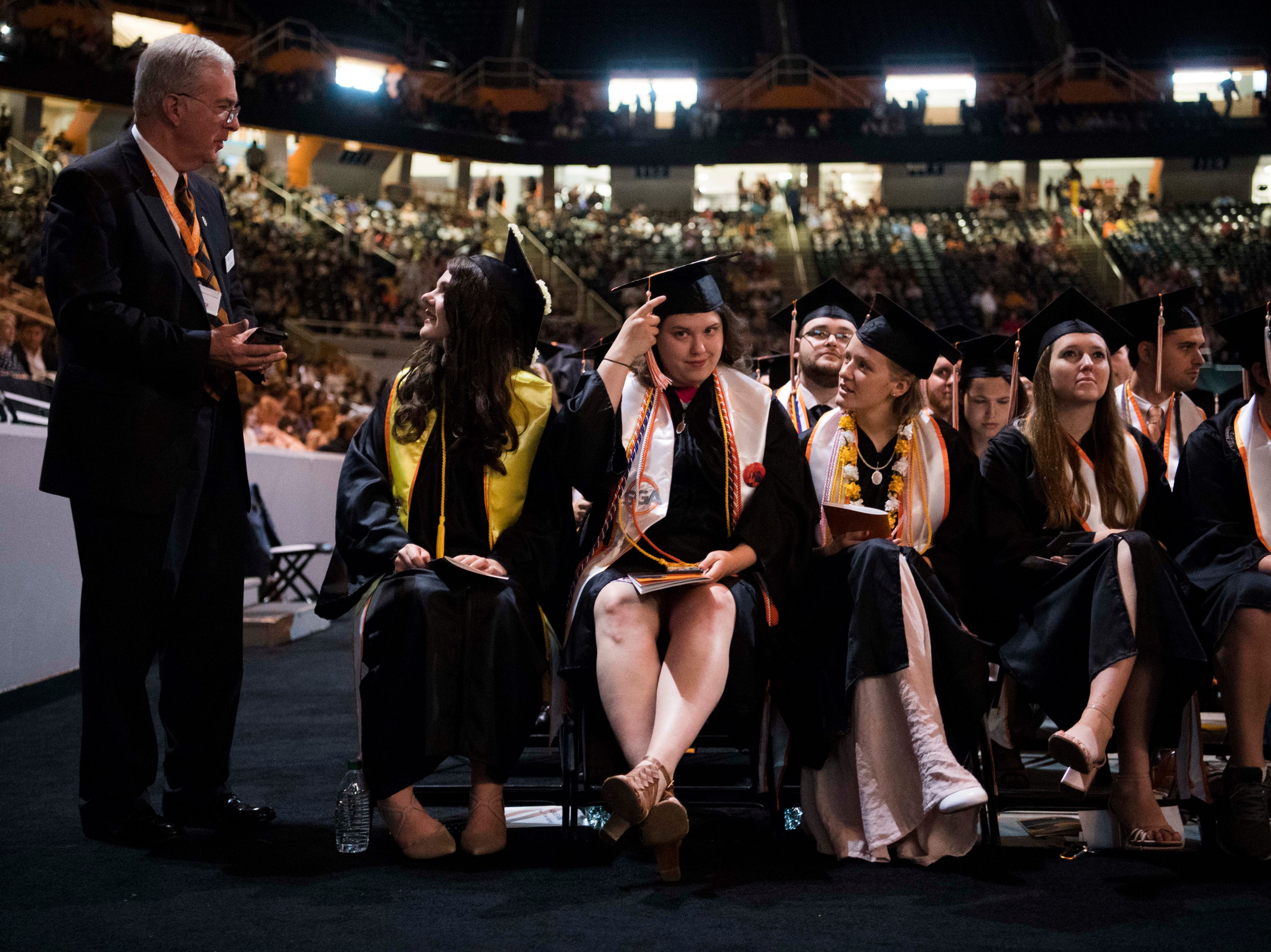 Students wait before the University of Tennessee's College of Arts and Sciences commencement in Thompson-Boling arena in Knoxville, Saturday, May 11, 2019.