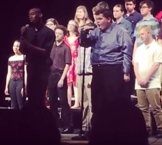 """A video of Tommy Sondgerath, a Harrison High School sophomore, right, singing a duet of """"A Million Dreams"""" with classmate Kris Wilkerson went viral after his parents and Autism Speaks posted about his joyous reaction to nailing his performance during the school's Spring Choir Concert on May 2, 2019, at the school in West Lafayette."""