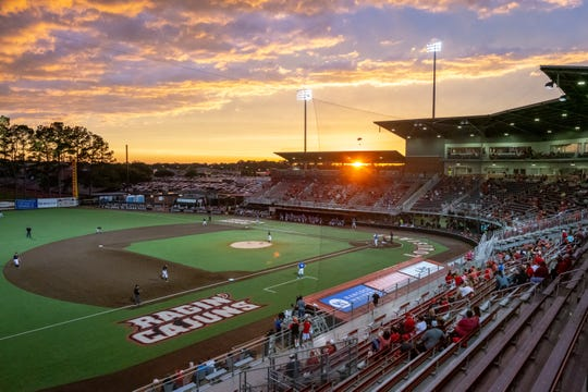 """The sun sets Friday night on M.L. """"Tigue"""" Moore Field at Russo Park during UL's 2-0 win over Georgia State."""