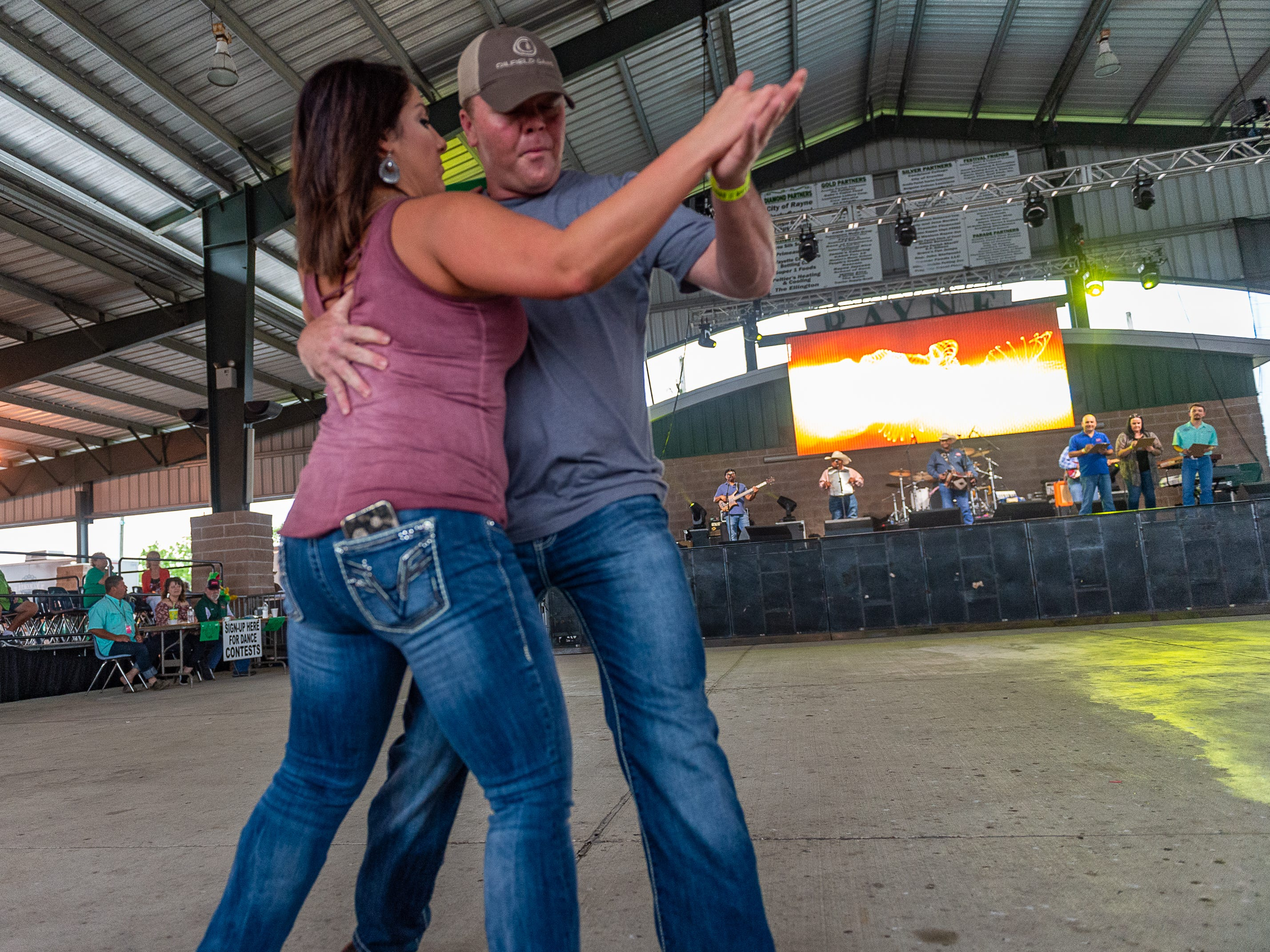 Jason and Renee Broussard win the waltz dance contest at The Rayne Frog Festival features music, food and events. Friday, May 10, 2019.