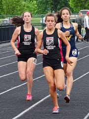 Fairfield Union's Mackenzie Davis leads the way during the 1,600 and is followed by teammate Madison Eyman during Friday's Mid-State League-Buckeye Division championships. The Falcons won their fifth consecutive league title.