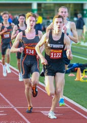 Plymouth's Carter Solomon (1122) leads Brighton's Jack Spamer (534) and Hartland's Riley Hough (right) in the 3,200-meter run at the KLAA track and field meet on Friday, May 10, 2019.